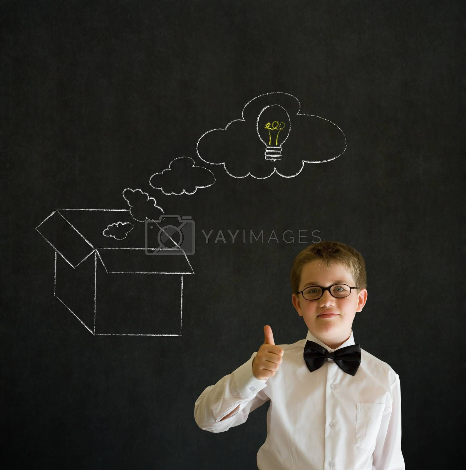 Royalty free image of Thumbs up boy business man with thinking out the box concept by alistaircotton