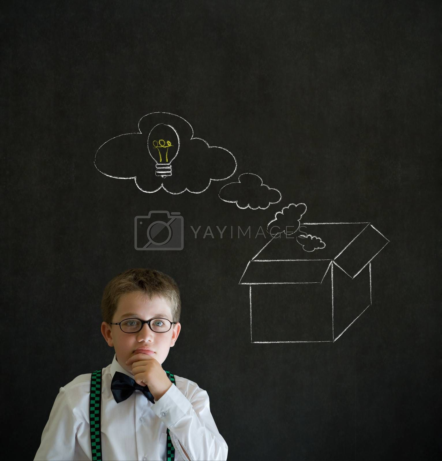 Royalty free image of Thinking boy business man with thinking out the box concept by alistaircotton
