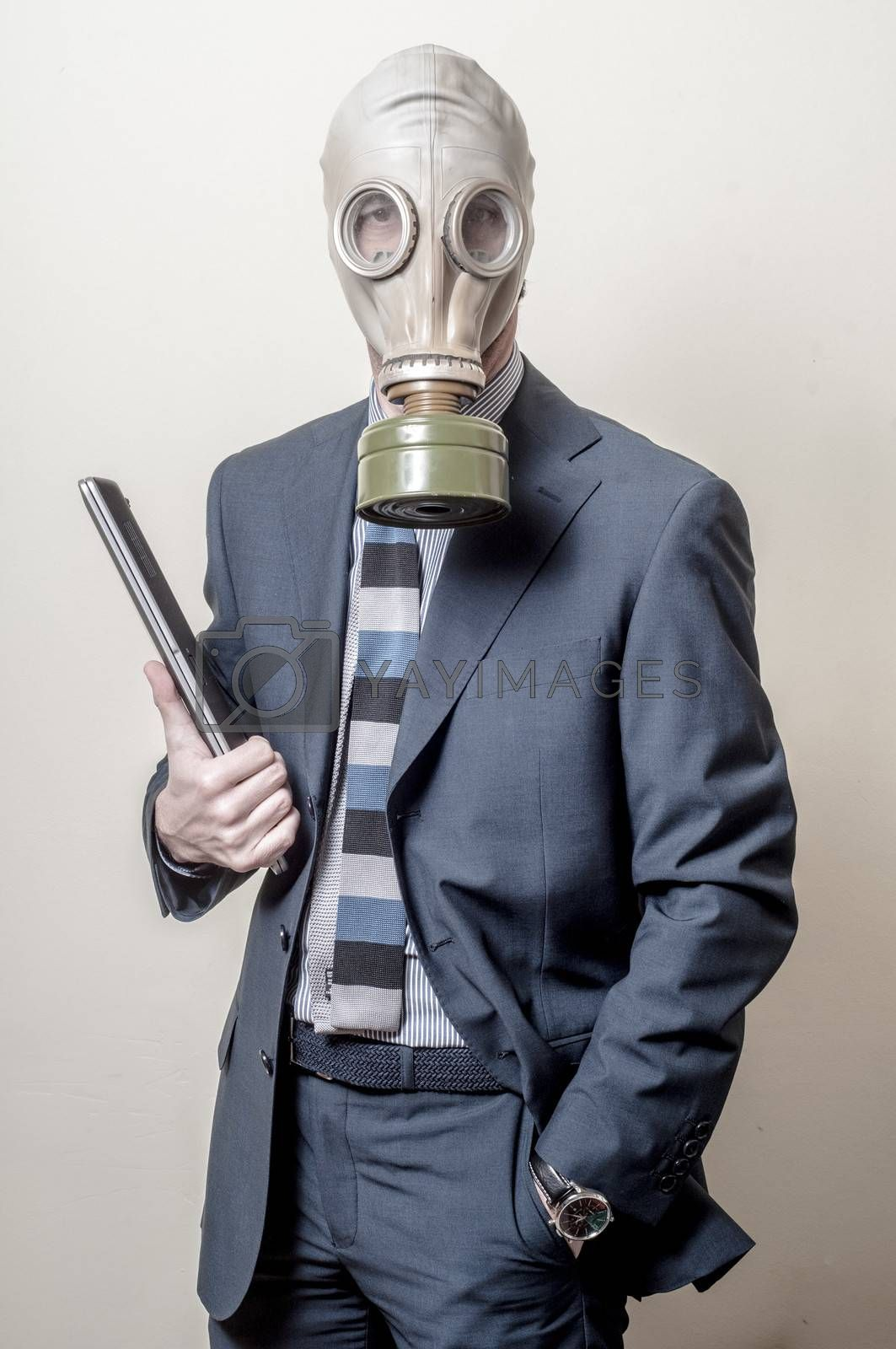 Royalty free image of businessman with gas mask with notebook by peus