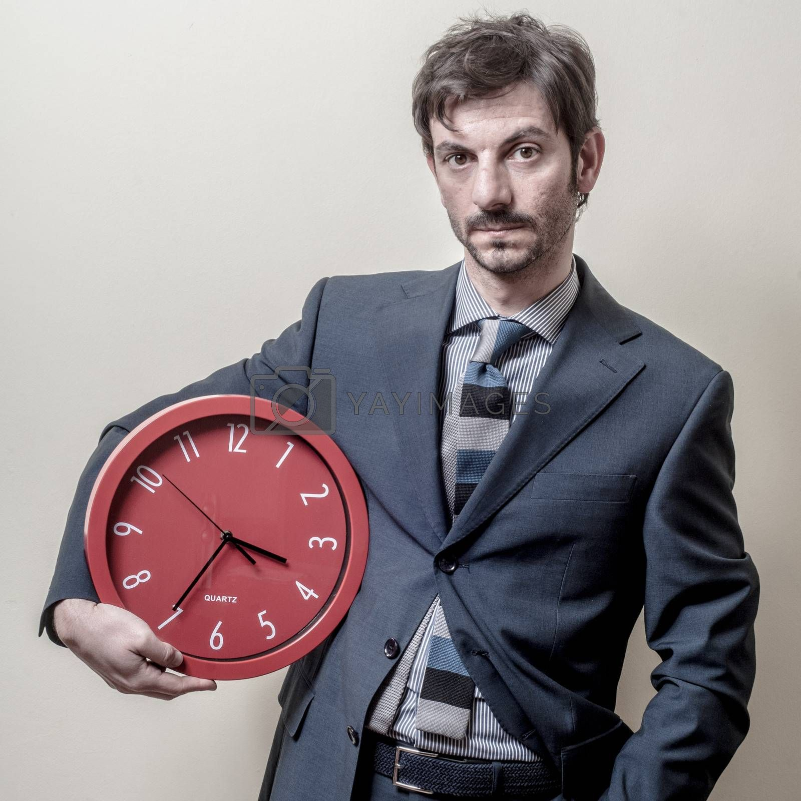 Royalty free image of businessman with clock by peus