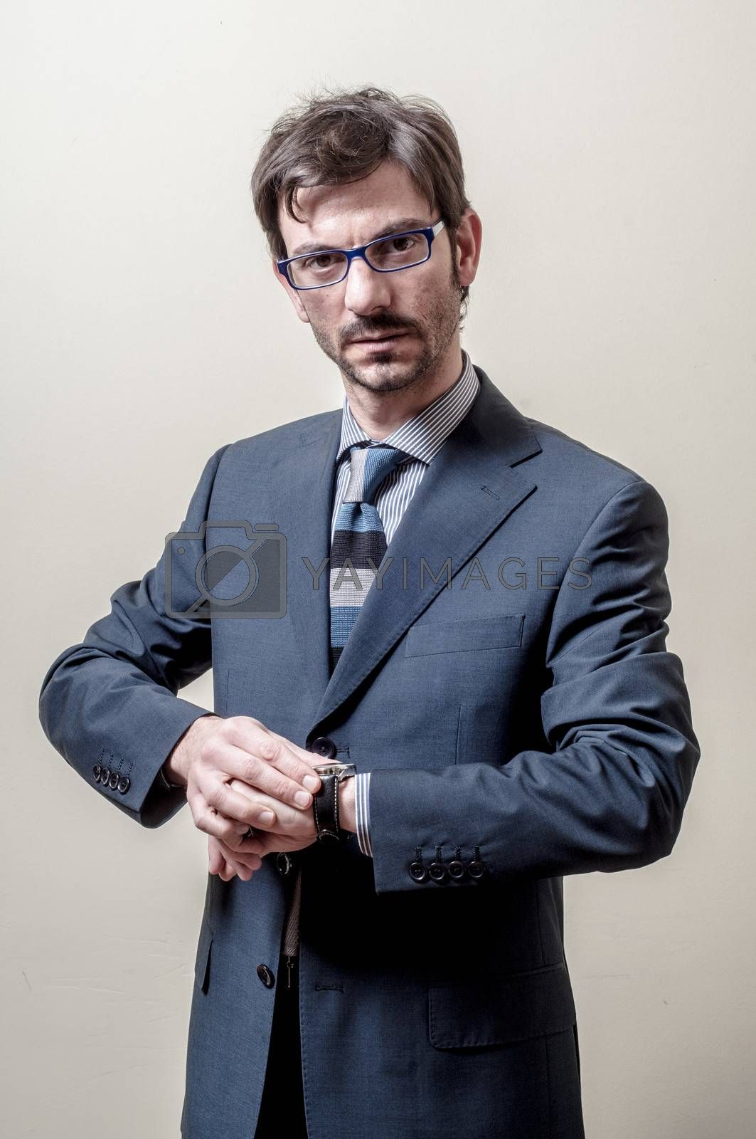 Royalty free image of businessman looking wristwatch by peus