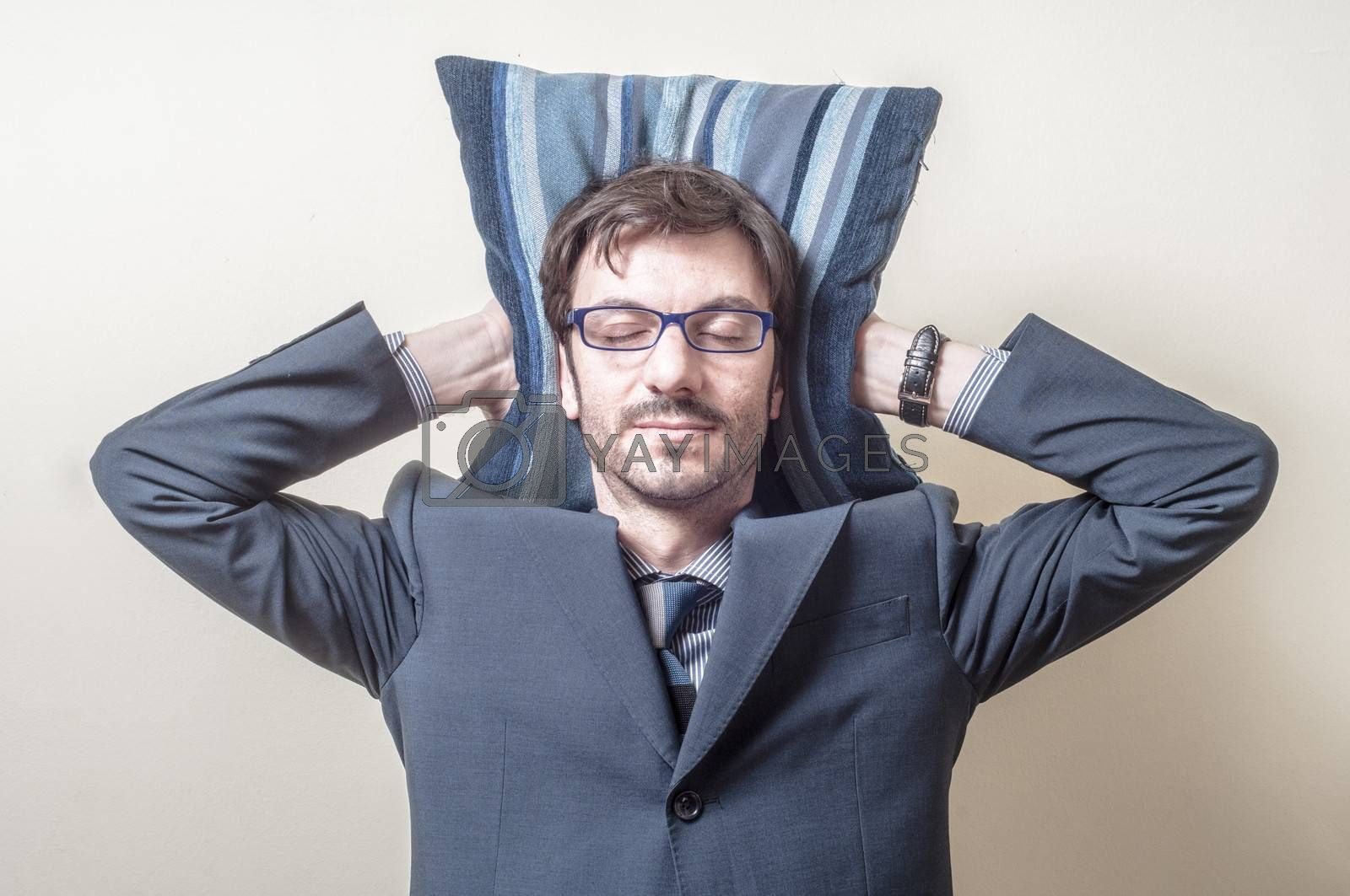Royalty free image of businessman sleeping on pillow by peus