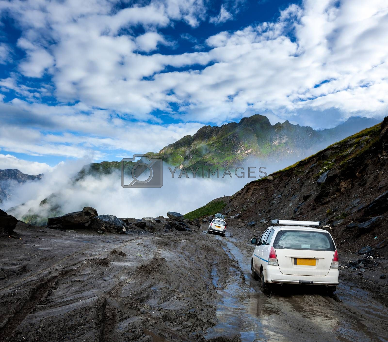 Royalty free image of Vehicles on bad road in Himalayas by dimol