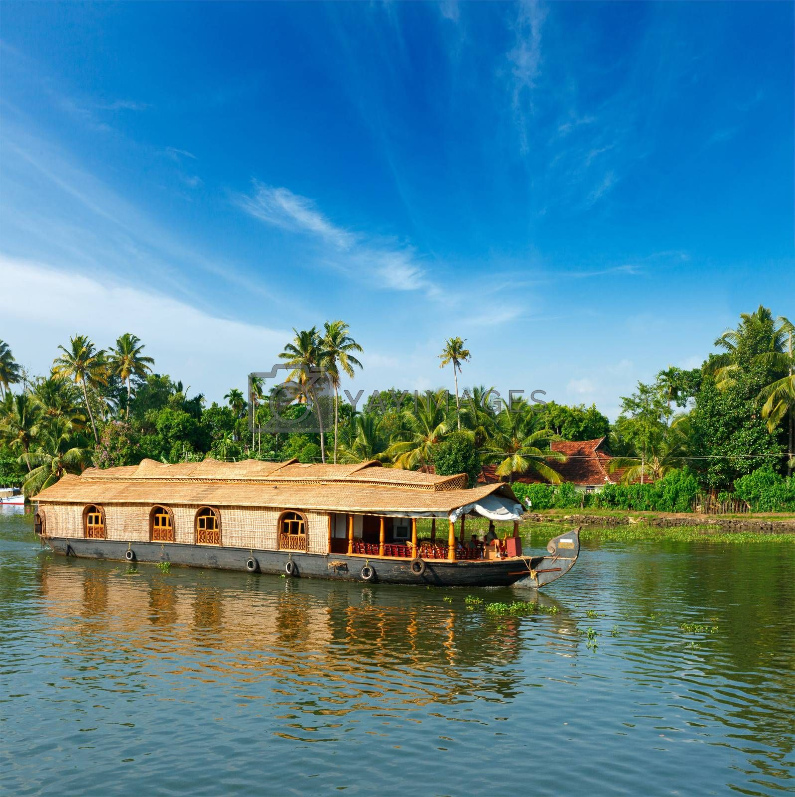 Royalty free image of Houseboat on Kerala backwaters, India by dimol