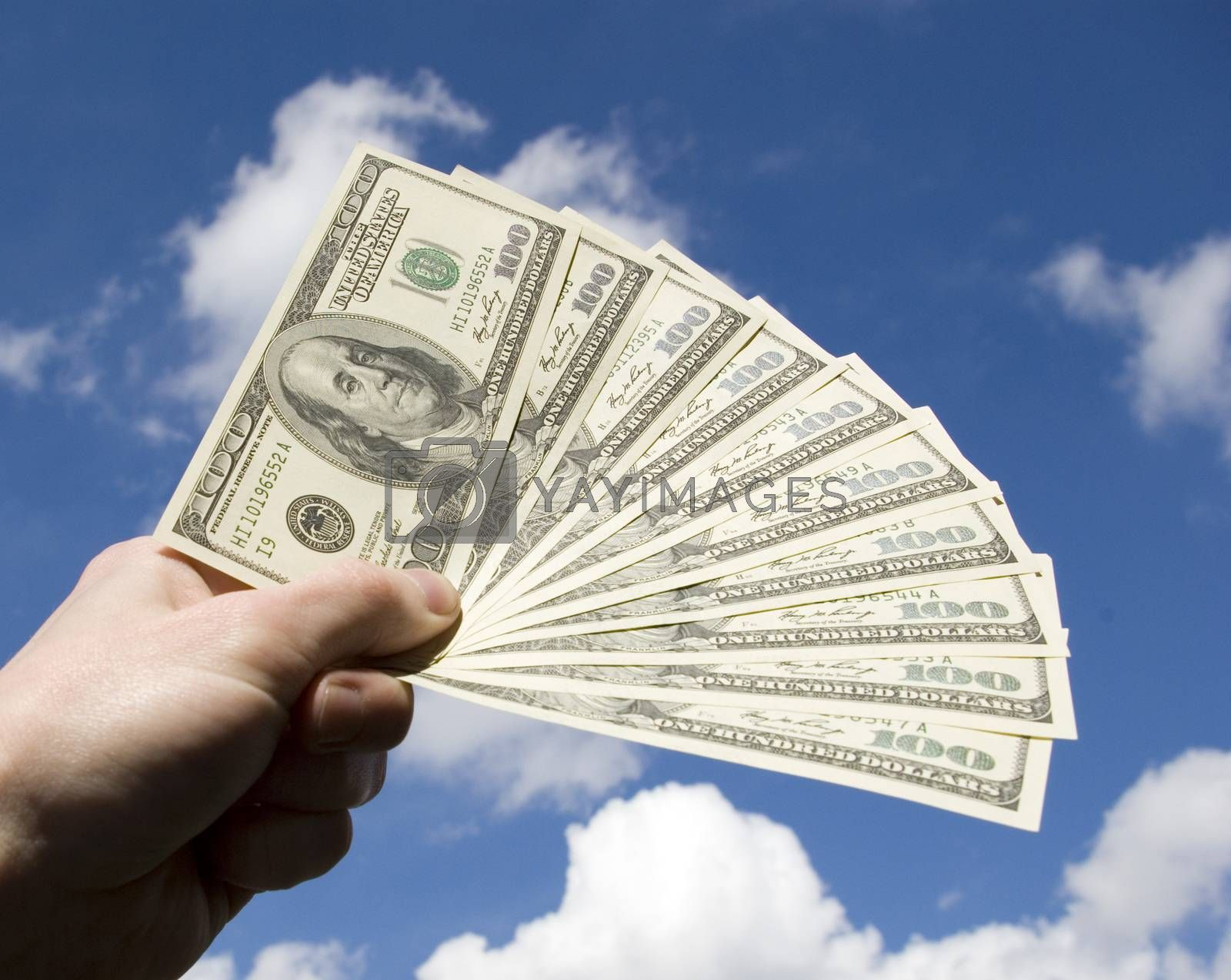 Royalty free image of Money in hand by Pakhnyushchyy