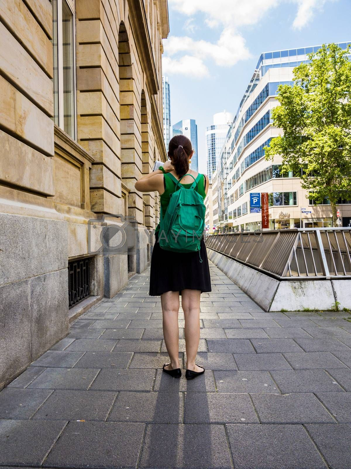 Royalty free image of attractive woman on the sidewalk downtown Frankfurt by meinzahn