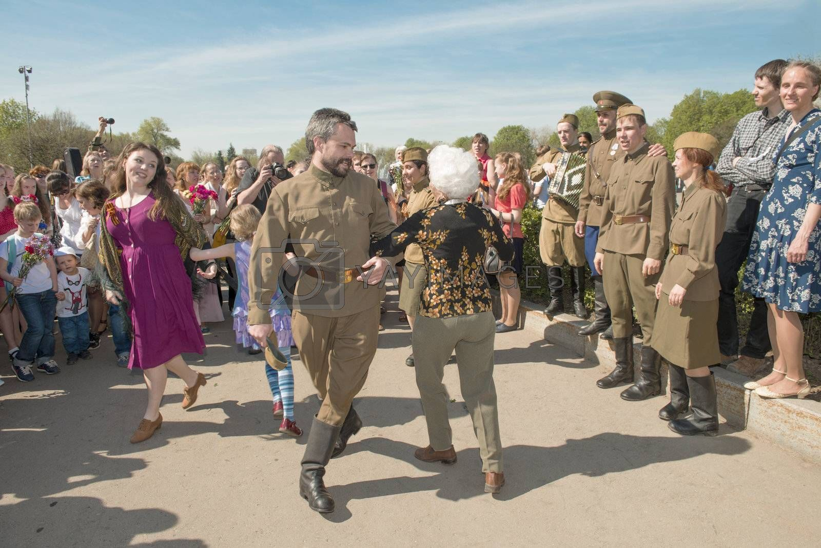 Moscow, Russia - May 9, 2013: Group of young peoples in uniform decorated dancing during with veterans festivities devoted to 68th anniversary of Victory Day.