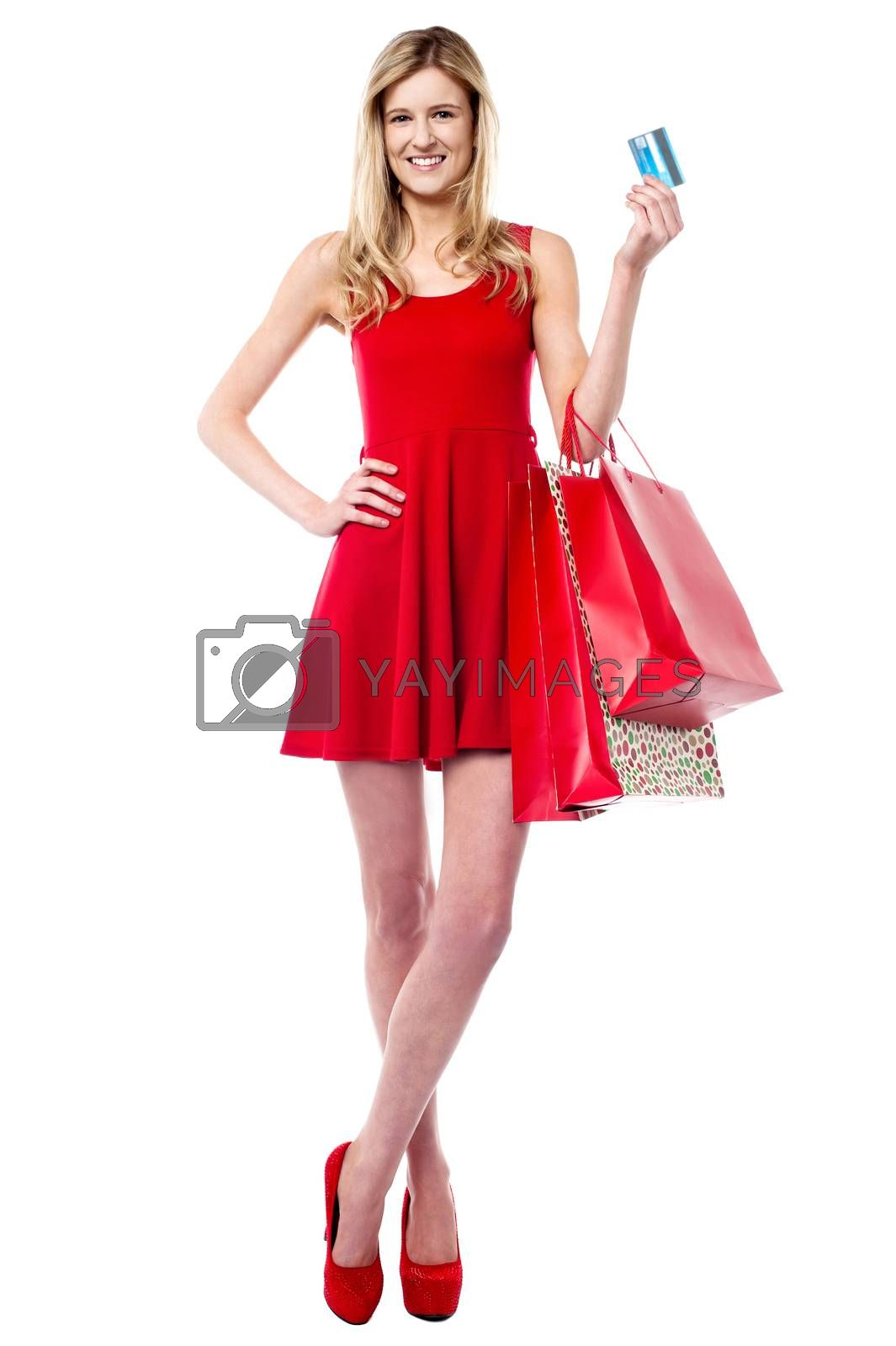 Fashion lady with shopping bags holding credit card and posing in style
