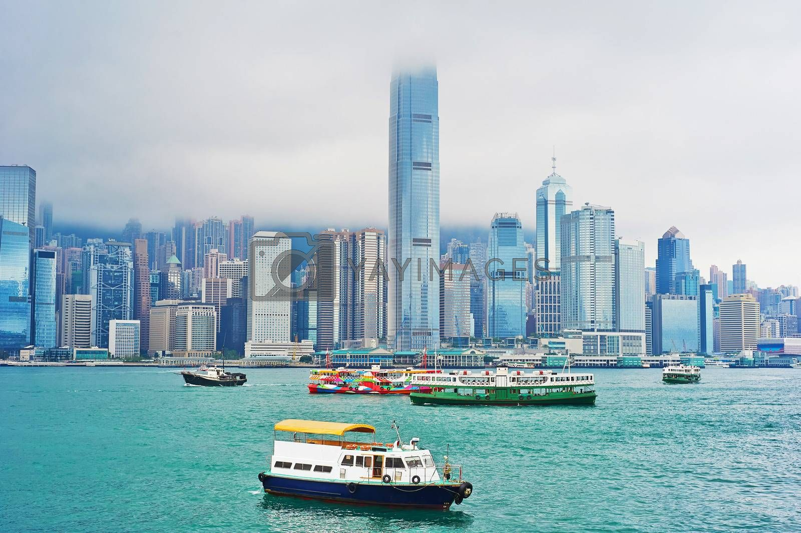 A lot of ships in Victoria harbor. View from Kowloon quayside. Hong Kong.