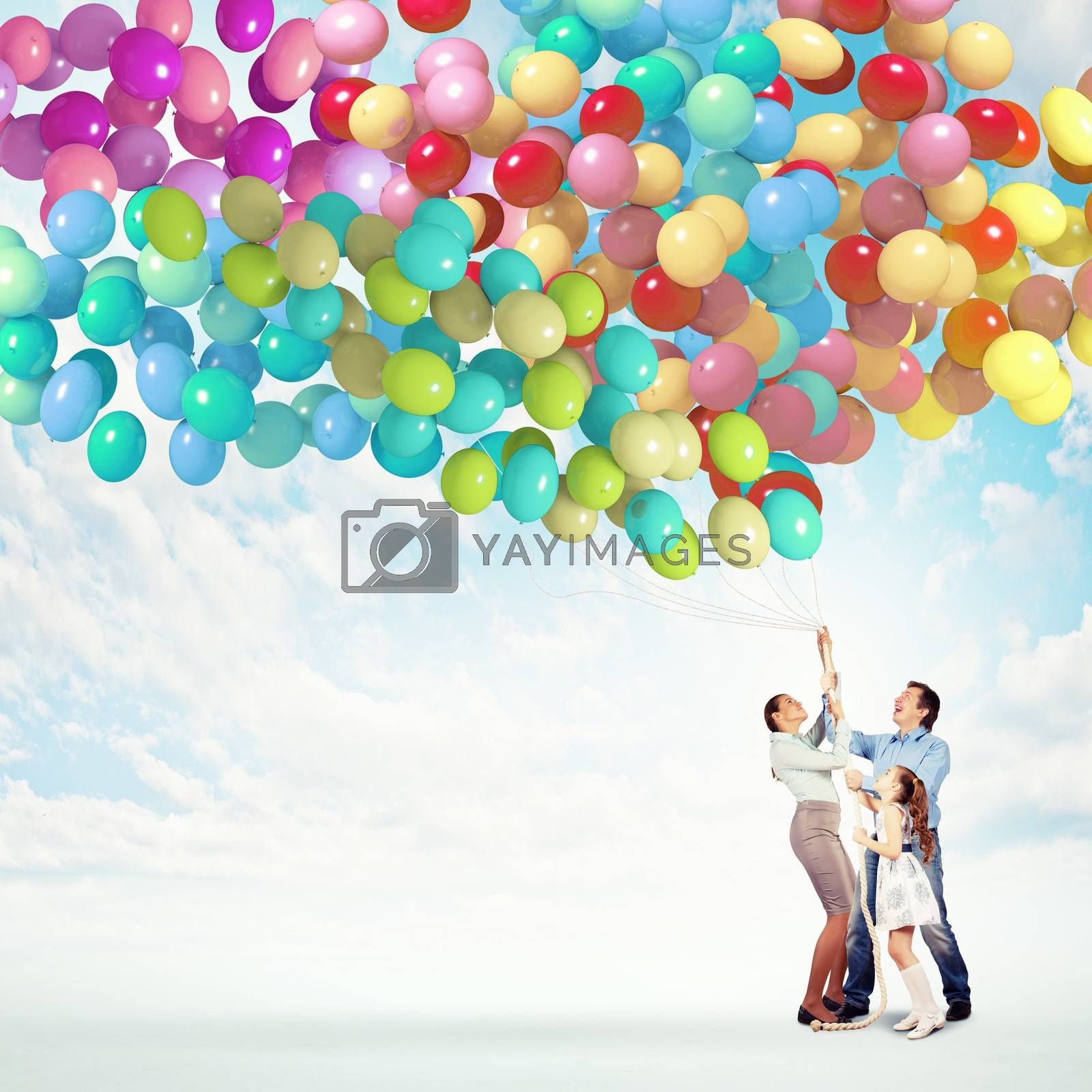 Image of happy family holding bunch of colorful balloons
