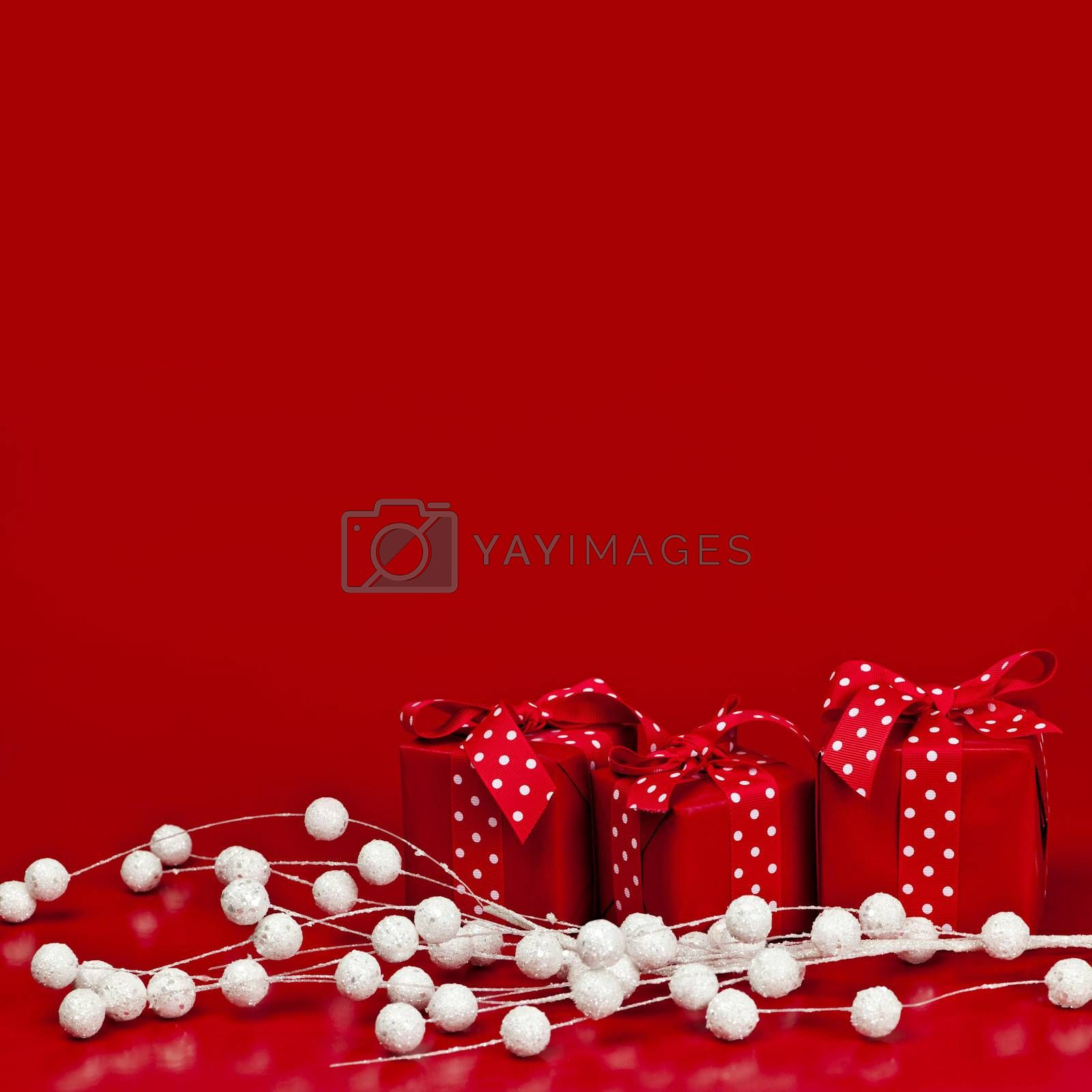 Red Christmas background with wrapped presents and decorations