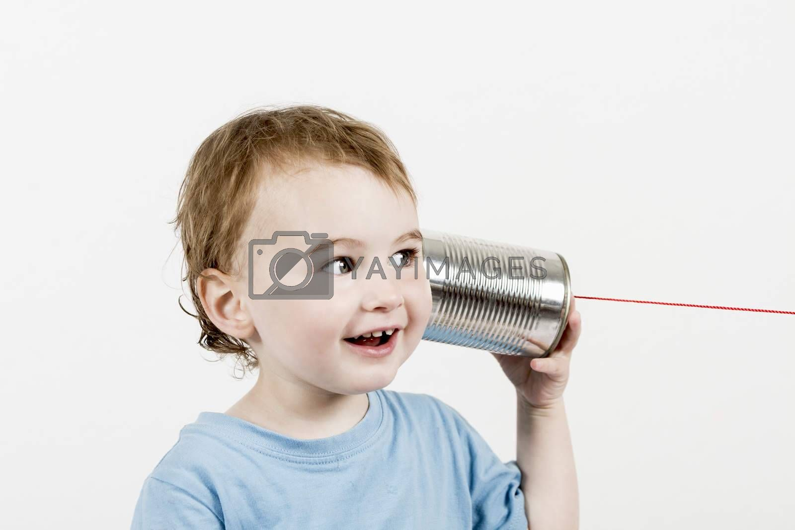 friendly child listening to tin can phone by gewoldi