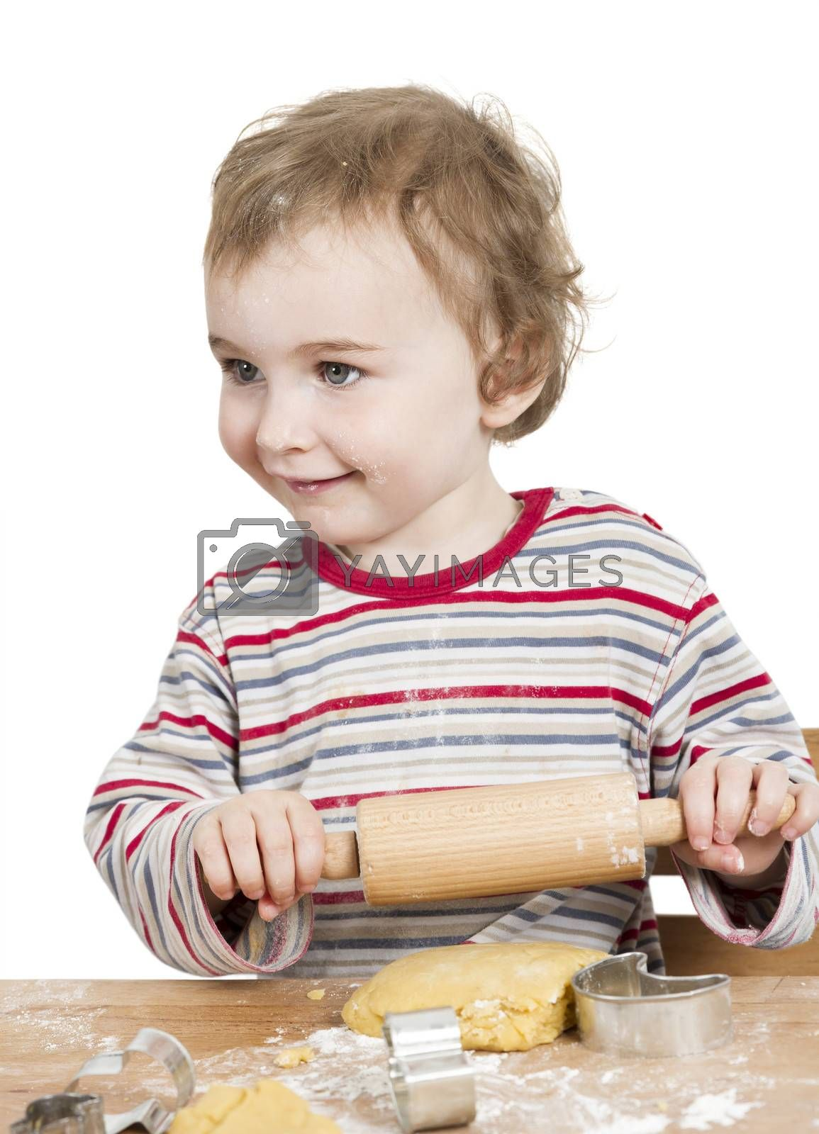 cute, laughing child with dough and rolling ping isolated on white background. horizontal image