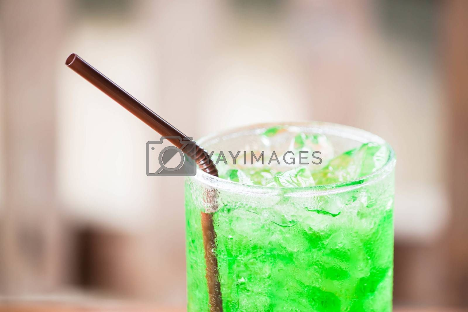 Close up ice cubes on green drink