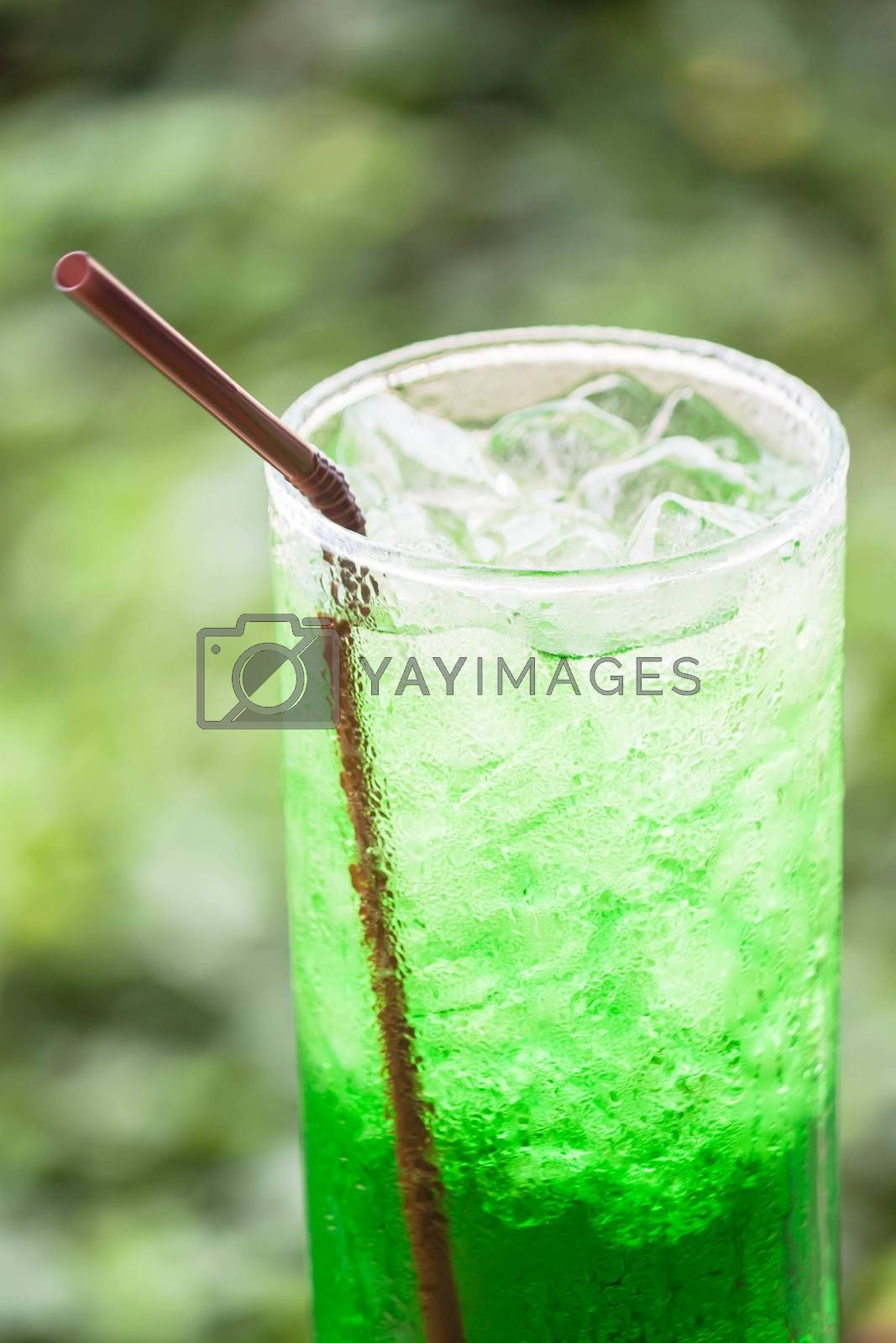 Non alcohol green drink with ice cubes