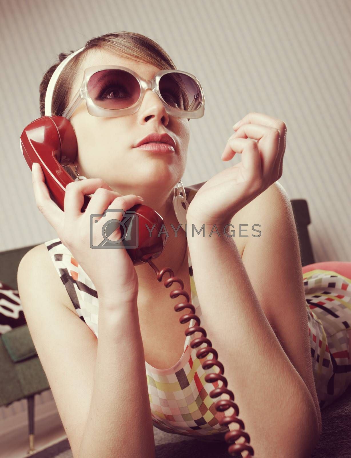 Fashion model talking on the phone at home