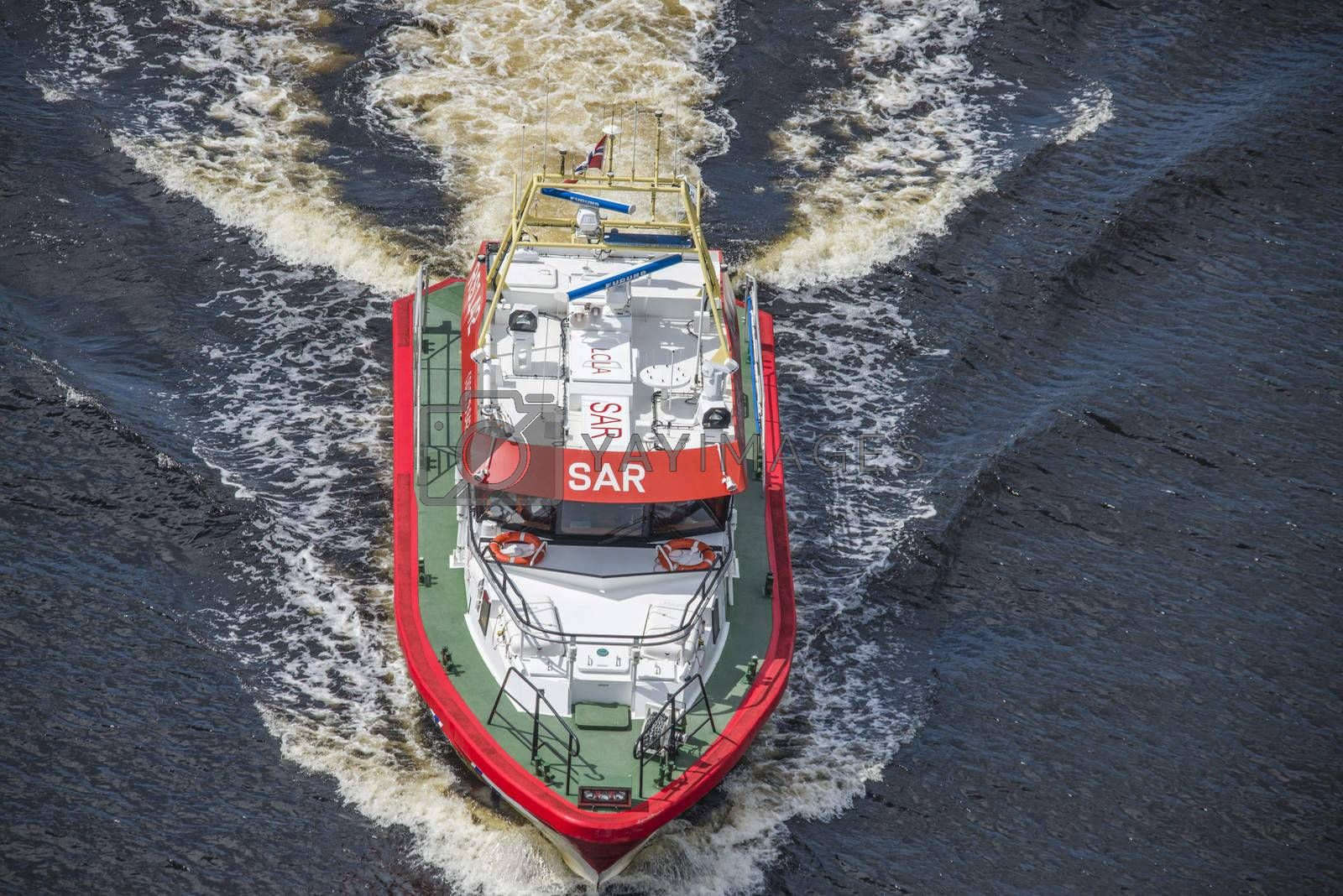 Rescue boat RS 142, Horn Flyer escorts MS Sj��kurs with NRK through Ringdalsfjord, heading for the port of Halden. Photo is shot from Svinesund bridge, Halden, Norway.