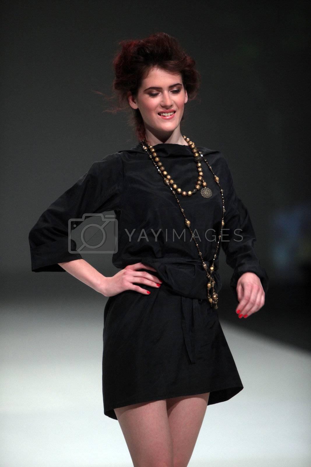 "ZAGREB, CROATIA - May 11: Fashion model wears clothes made by Ivana Popovic on ""ZAGREB FASHION WEEK"" show on May 11, 2013 in Zagreb, Croatia."