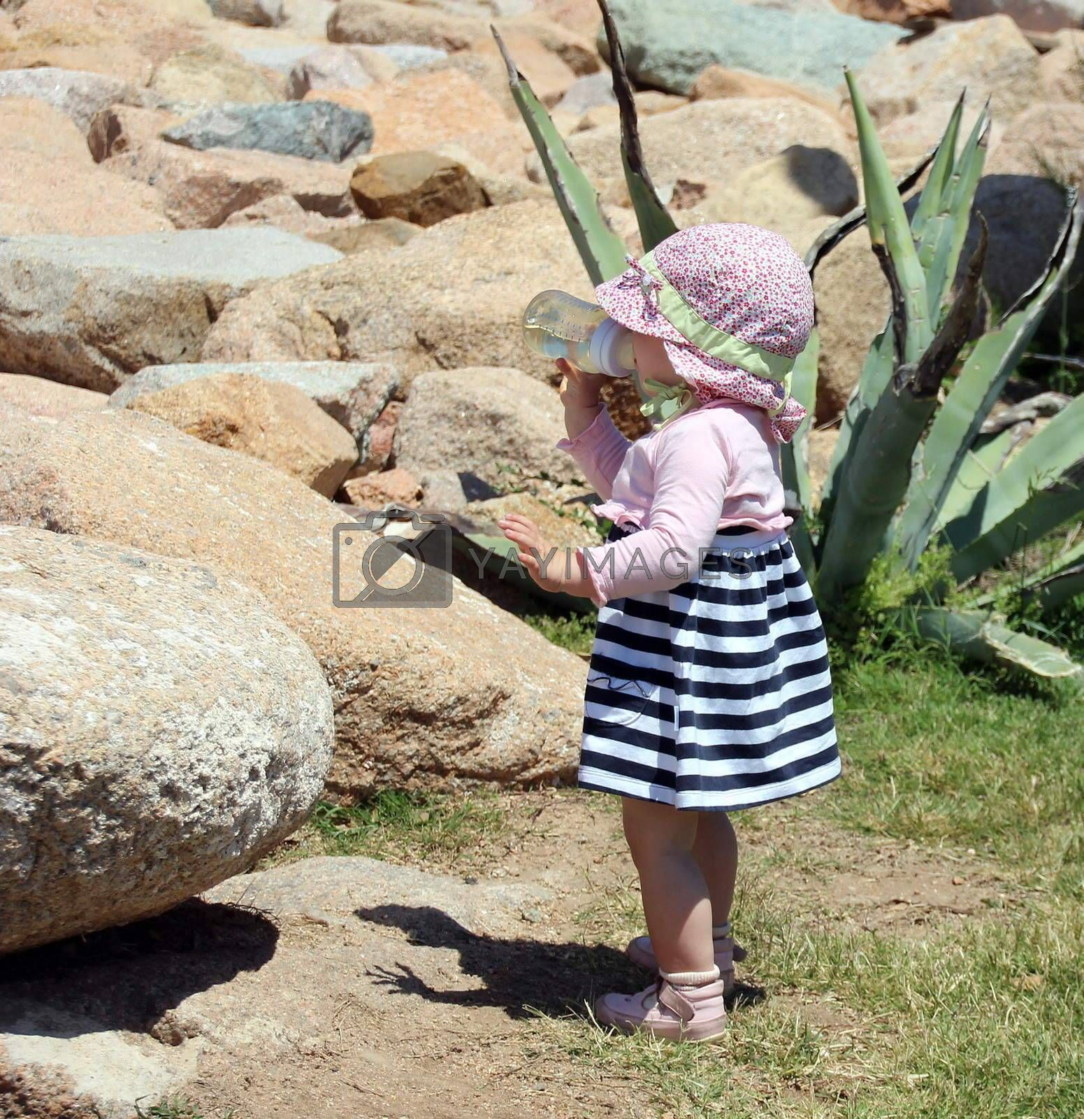 Little cute blond girl (one year and seven months of age) at the port in Porto Cervo. Sardinia