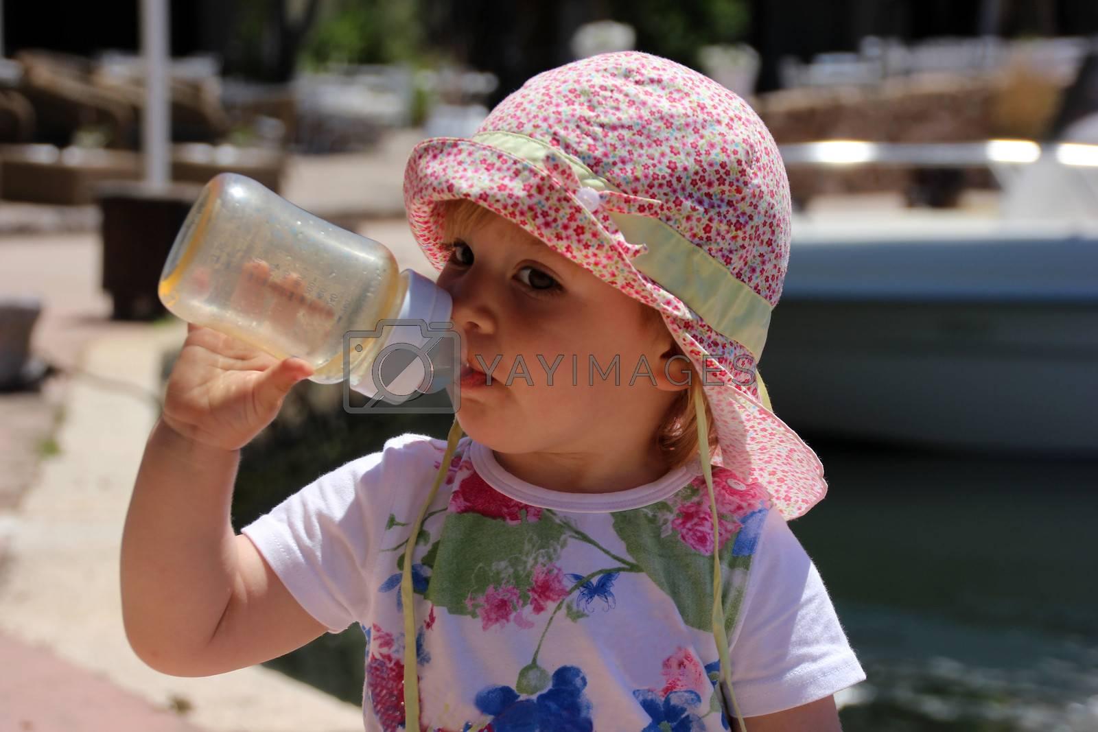 Portrait of little cute blond girl  on the port by Flik47