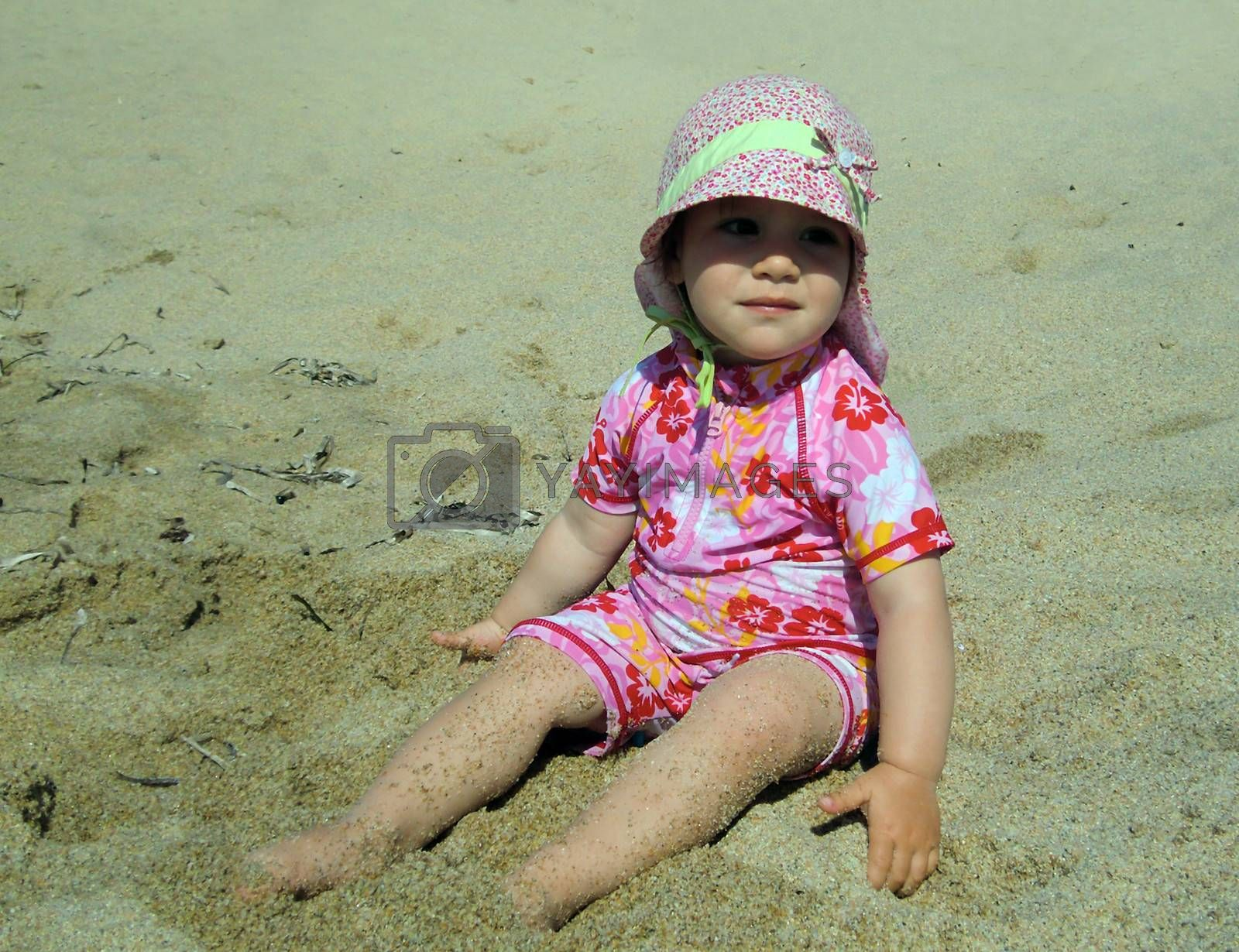 Portrait of little cute blond girl  on the beach by Flik47