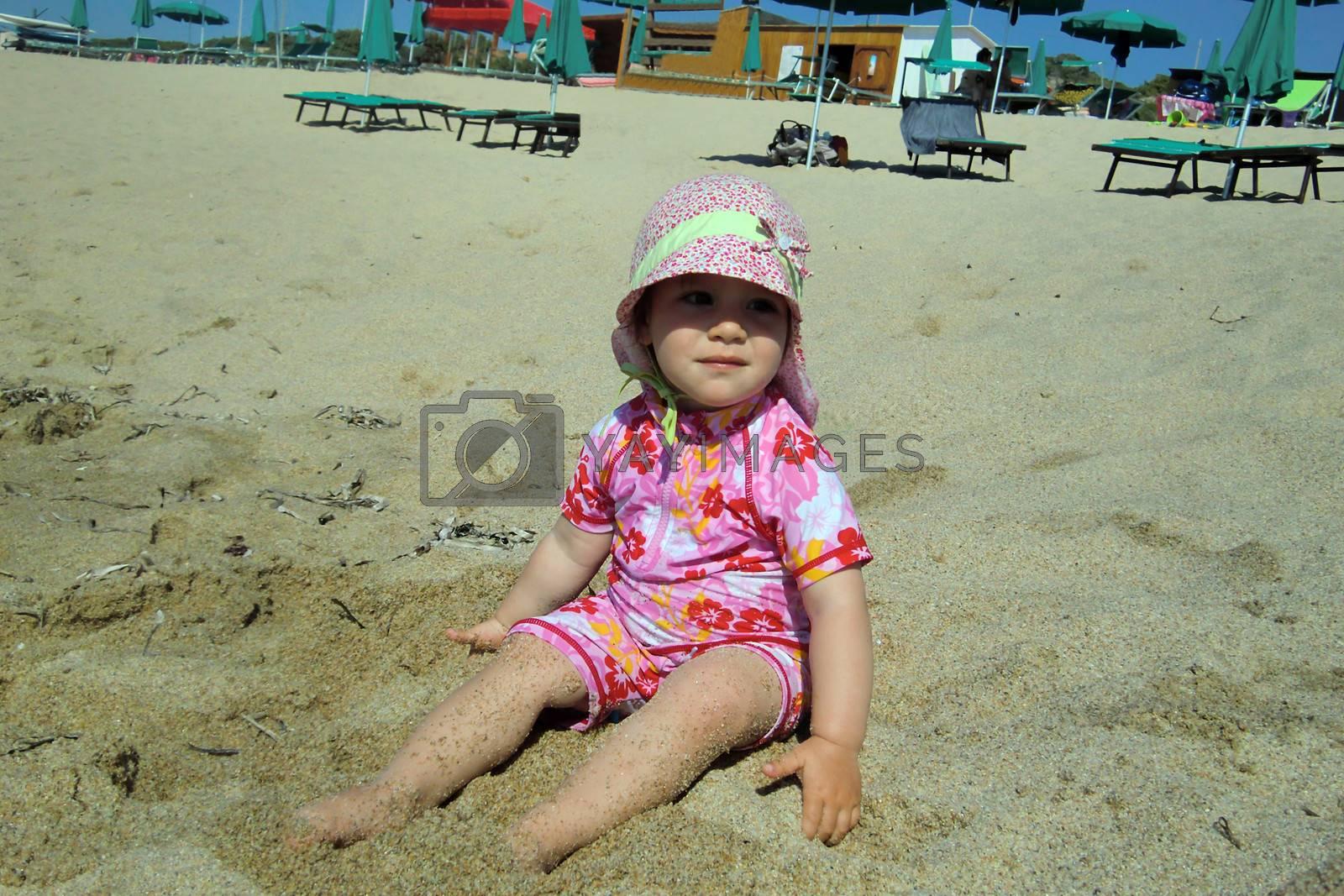 Portrait of little cute blond girl  on the beach by Flik47