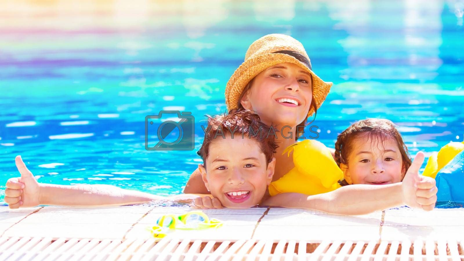 Happy family have fun in the pool, relaxation in aquapark, mother with two cute kids swimming in cool water, spending together summer vacation