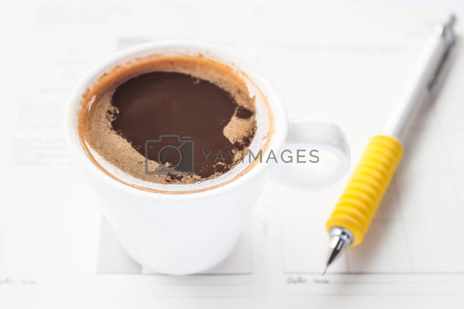 Work paper and pencil with espresso shot