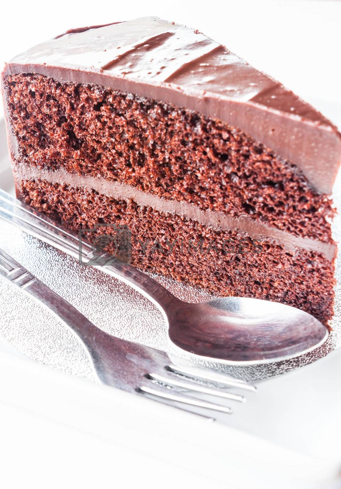 Piece of chocolate cake with spoon and fork