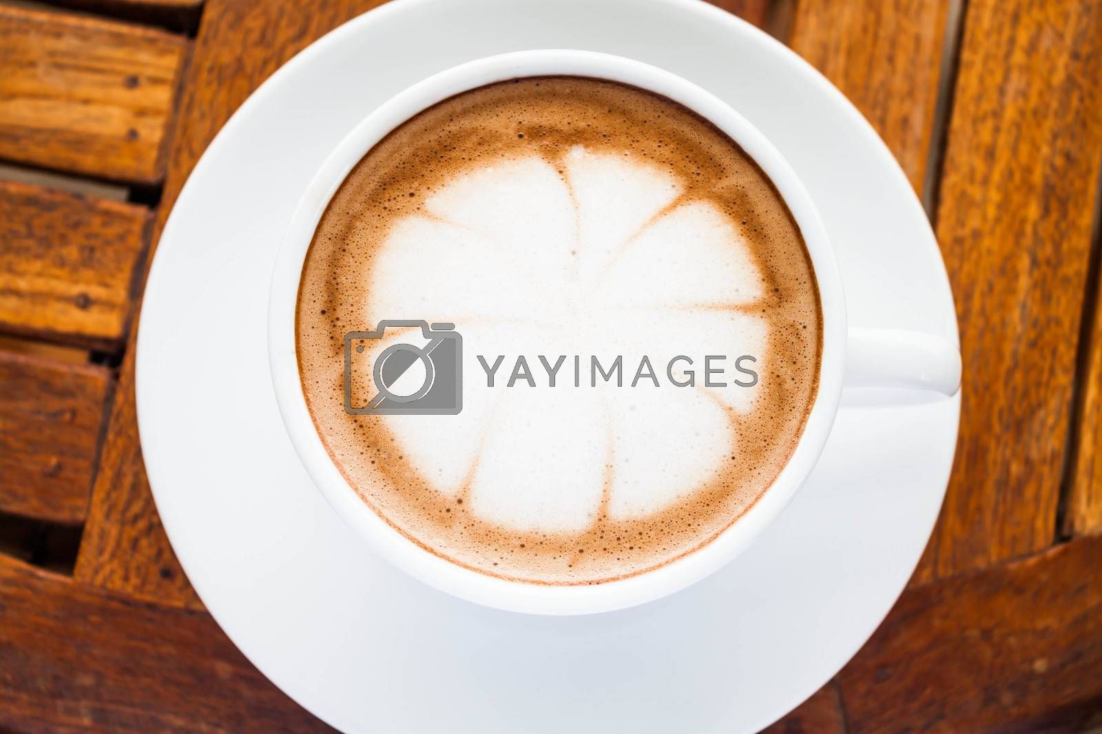 Beautiful cup of hot cafe mocha on wooden table