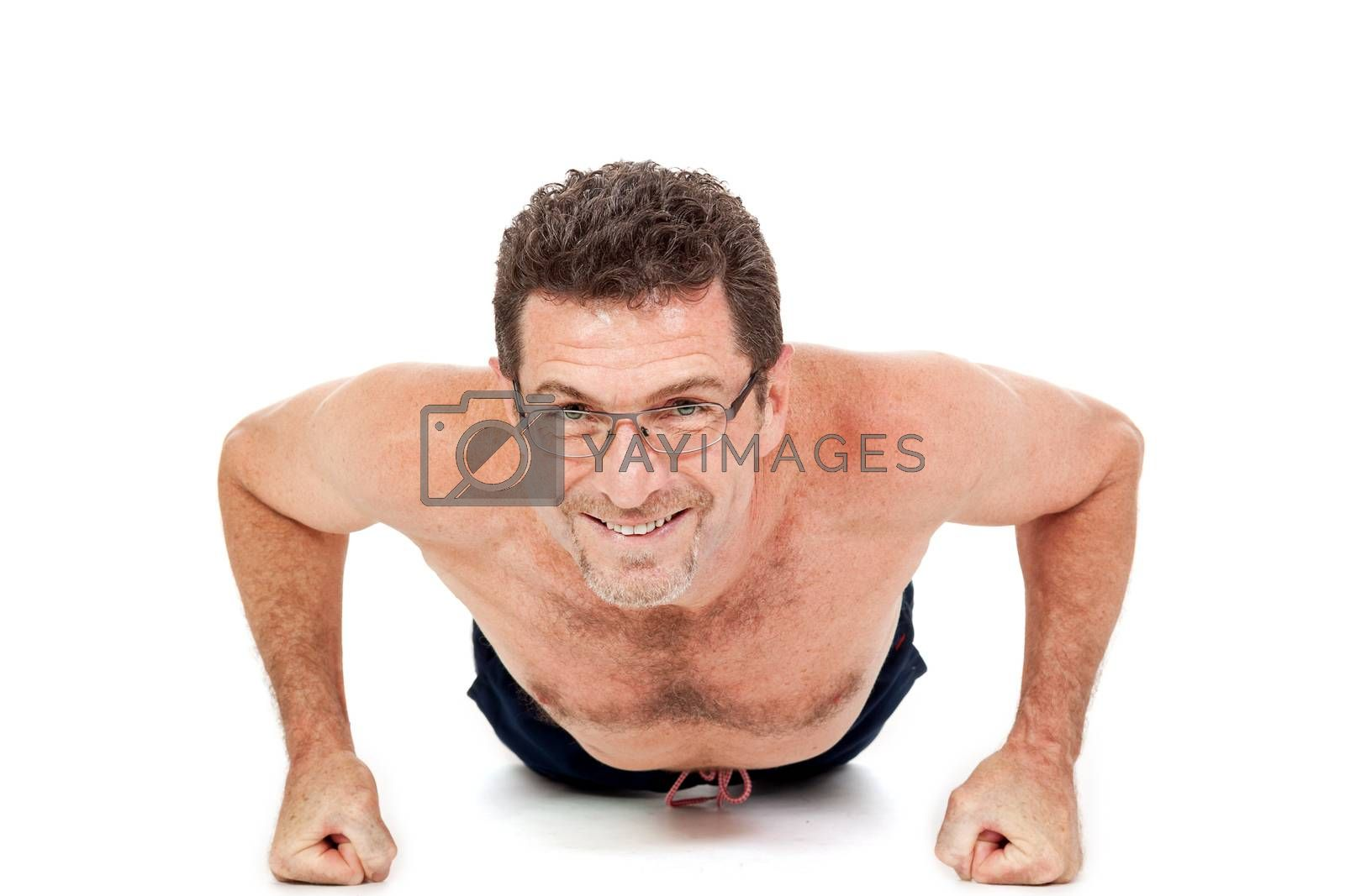 adult smiling man doing workout pushups fitness isolated on white