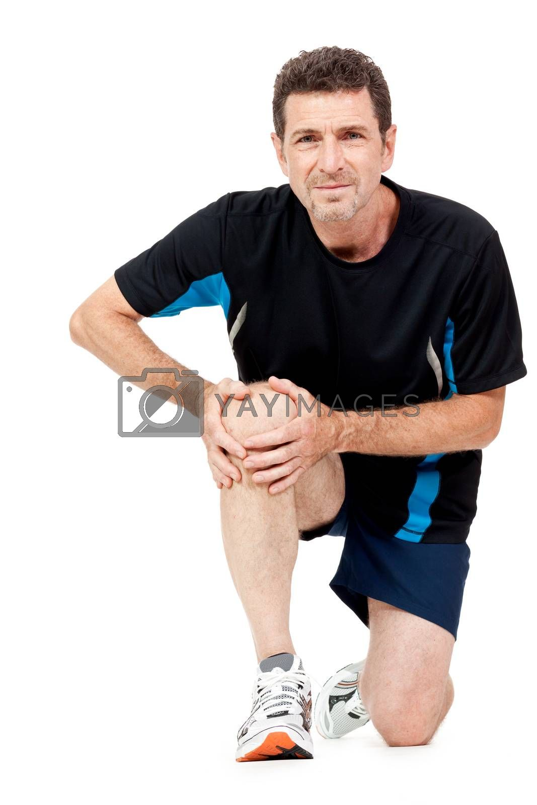 adult attractive man in sportswear knee pain injury ache isolated on white