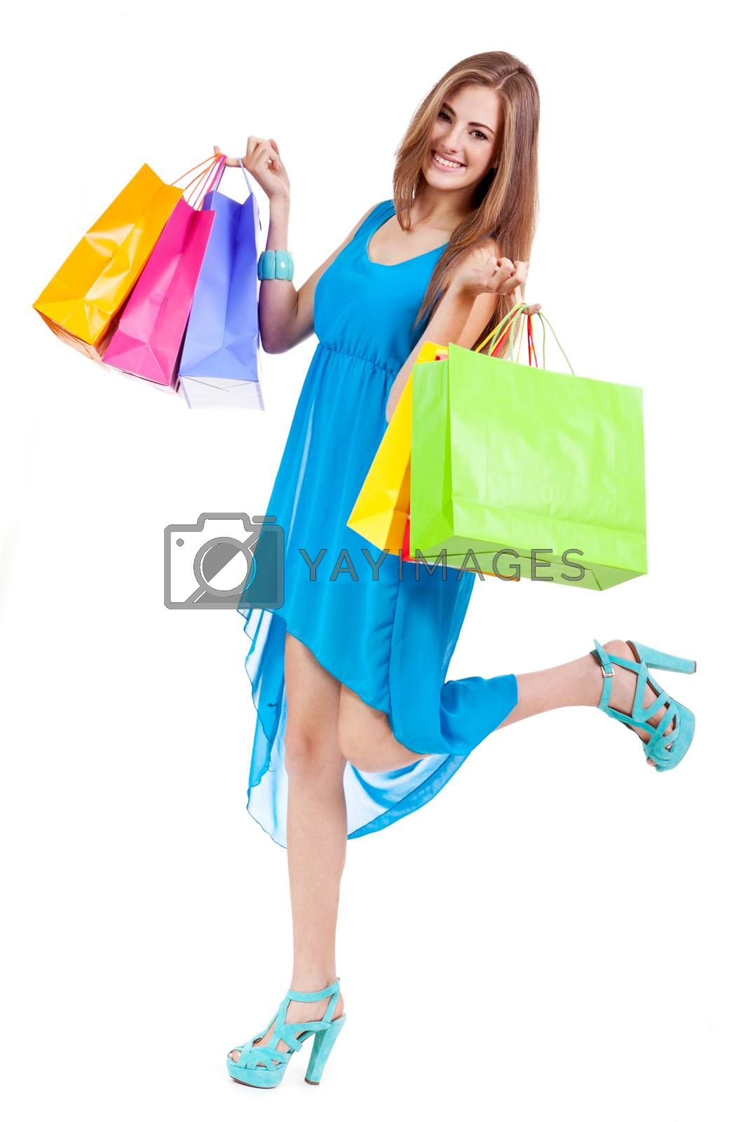 attractive young woman with colorful shopping bags isolated on white background