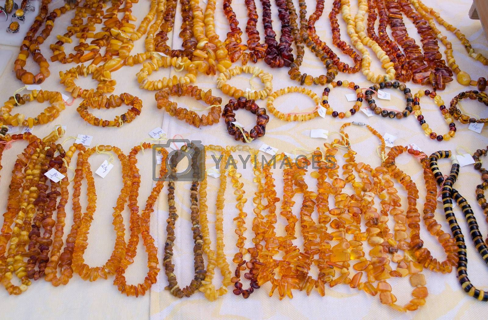 necklaces bracelet and other handmade jewelry. lithuanian national stone amber sold in city fair market.