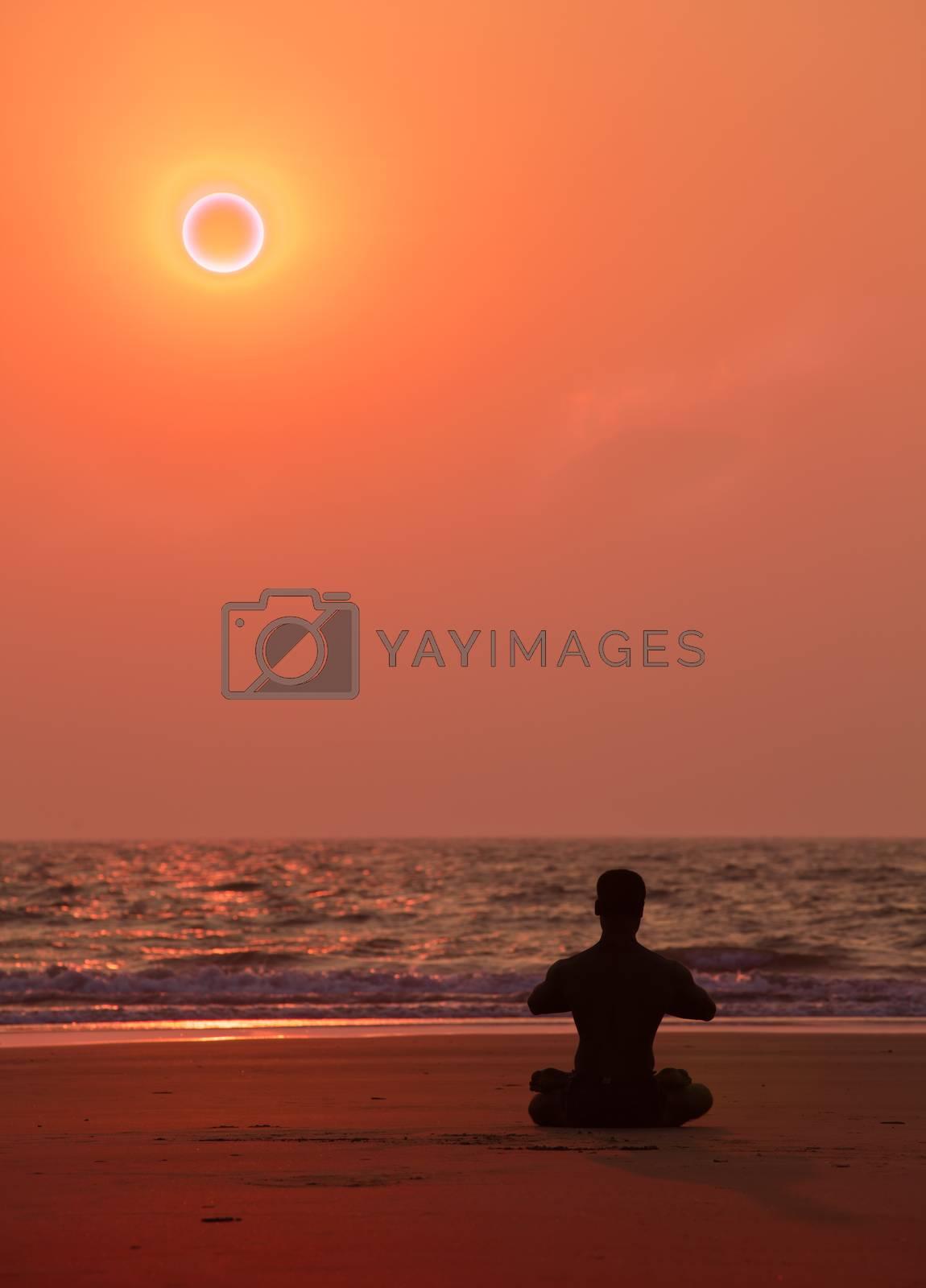Yoga on the beach in India  Sitting asana