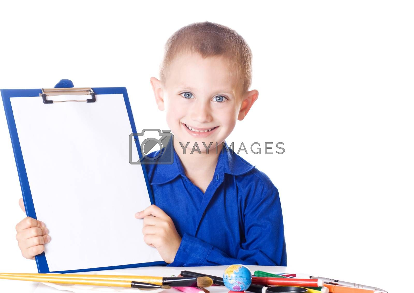 Schoolboy showing a blank sheet of paper