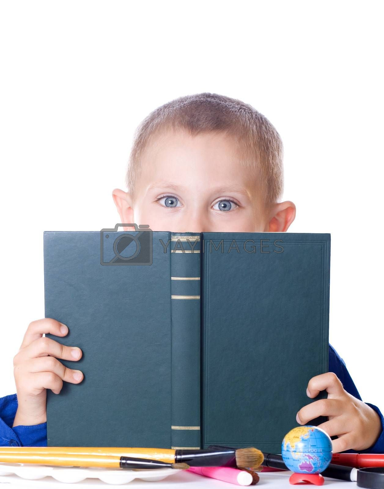 Schoolboy reading a book isolated on white background