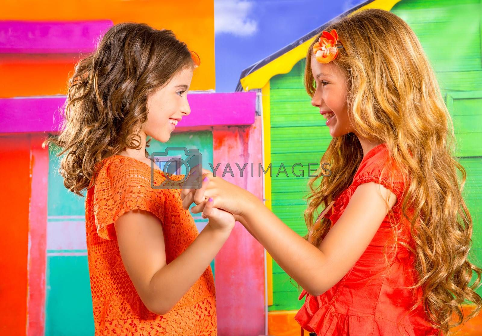 children firends girls playing together in vacation at tropical colorful house