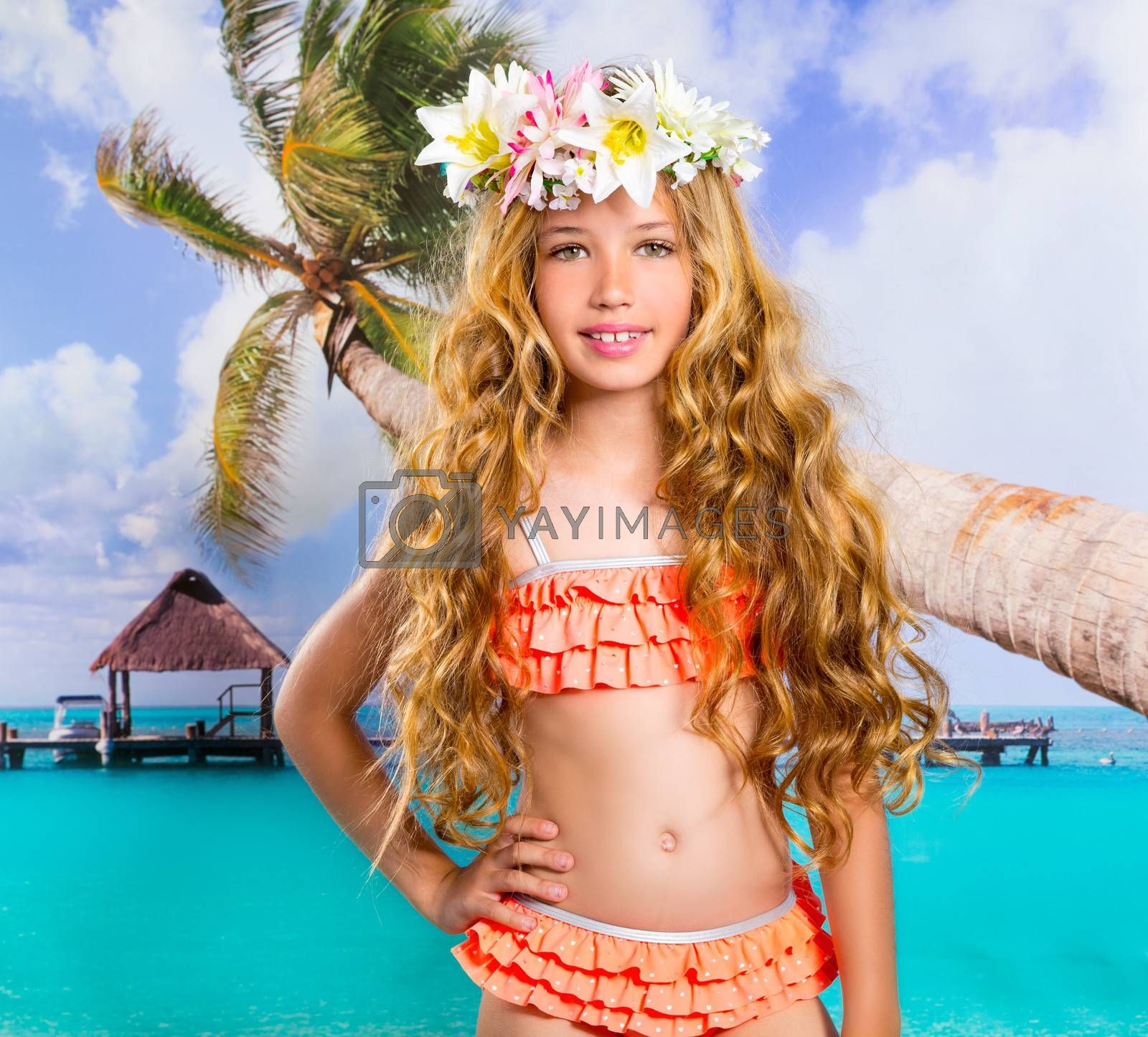 Beach tropical vacation kid blond girl with fashion flowers in head and palm tree