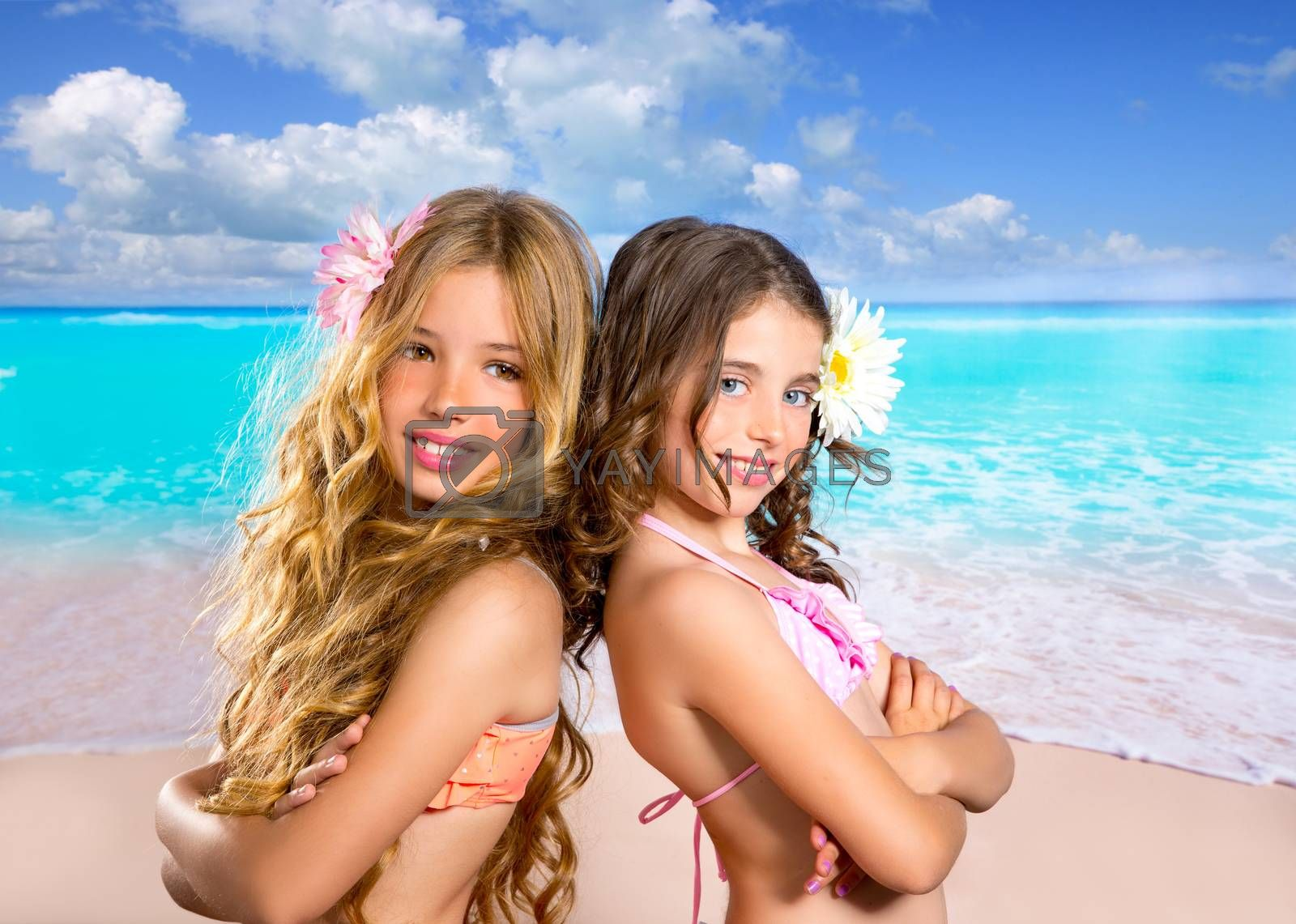 children friends girls happy together in tropical beach vacation