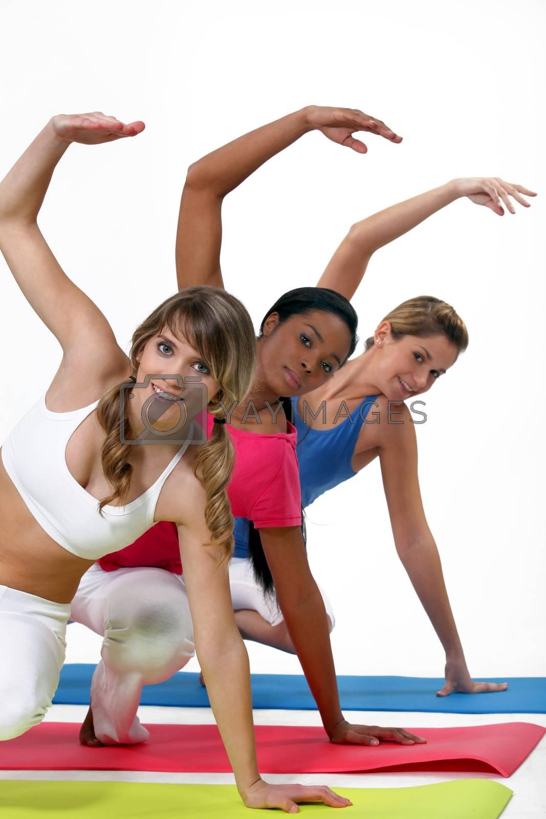Three women in gym class