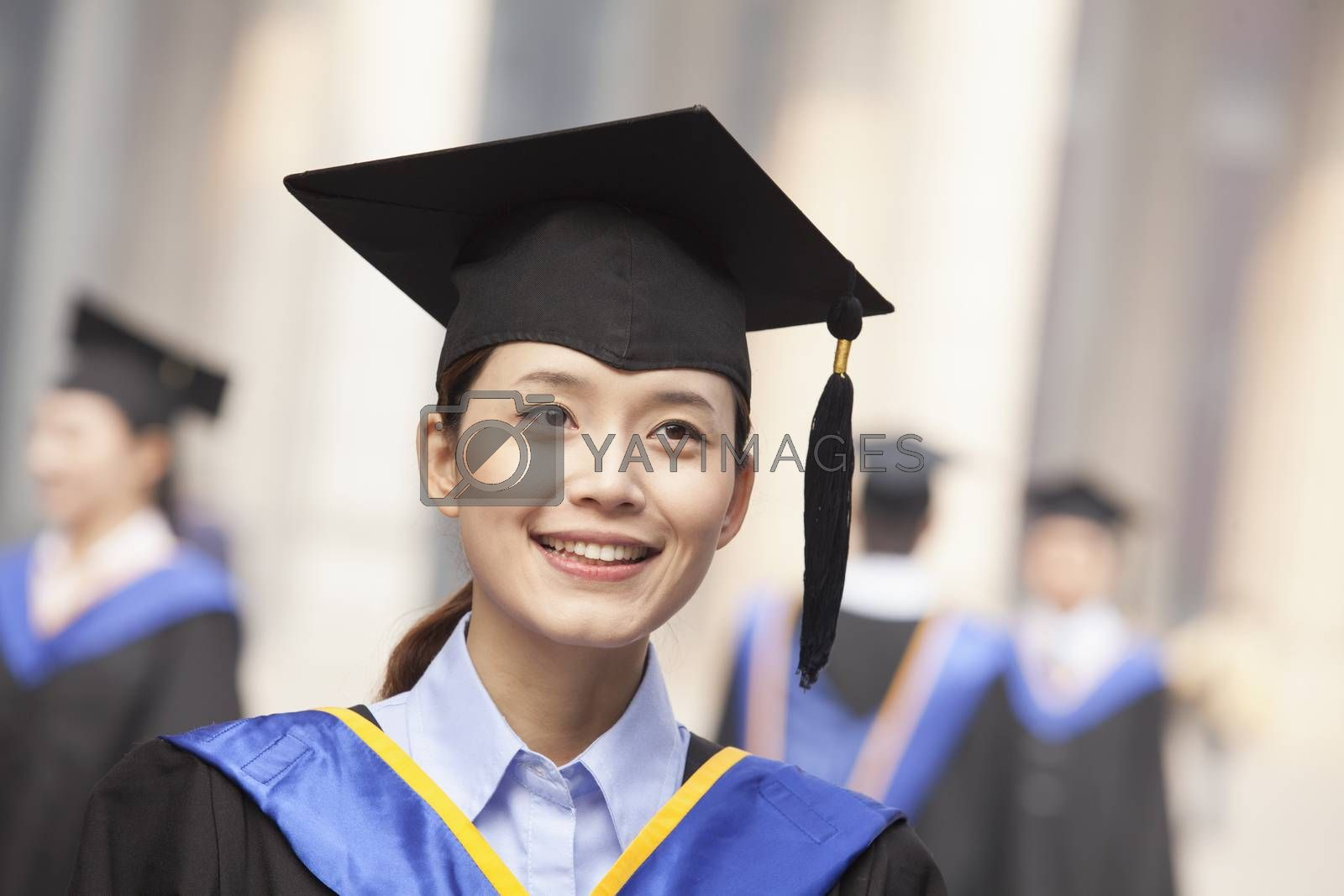 Young Female Graduate Smiling