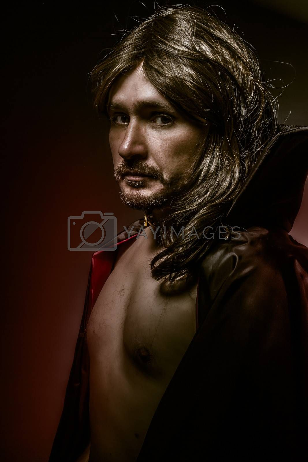 Sexy Young Vampire with black coat and long hair, nude