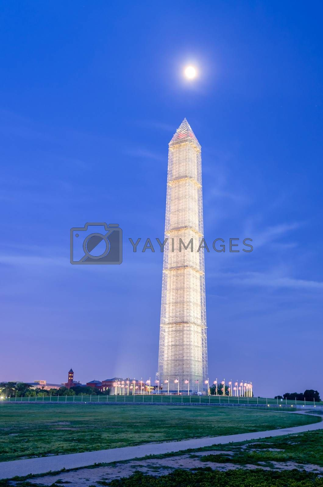 The Washington Memorial in Washington DC at Night against a scenic blue sky