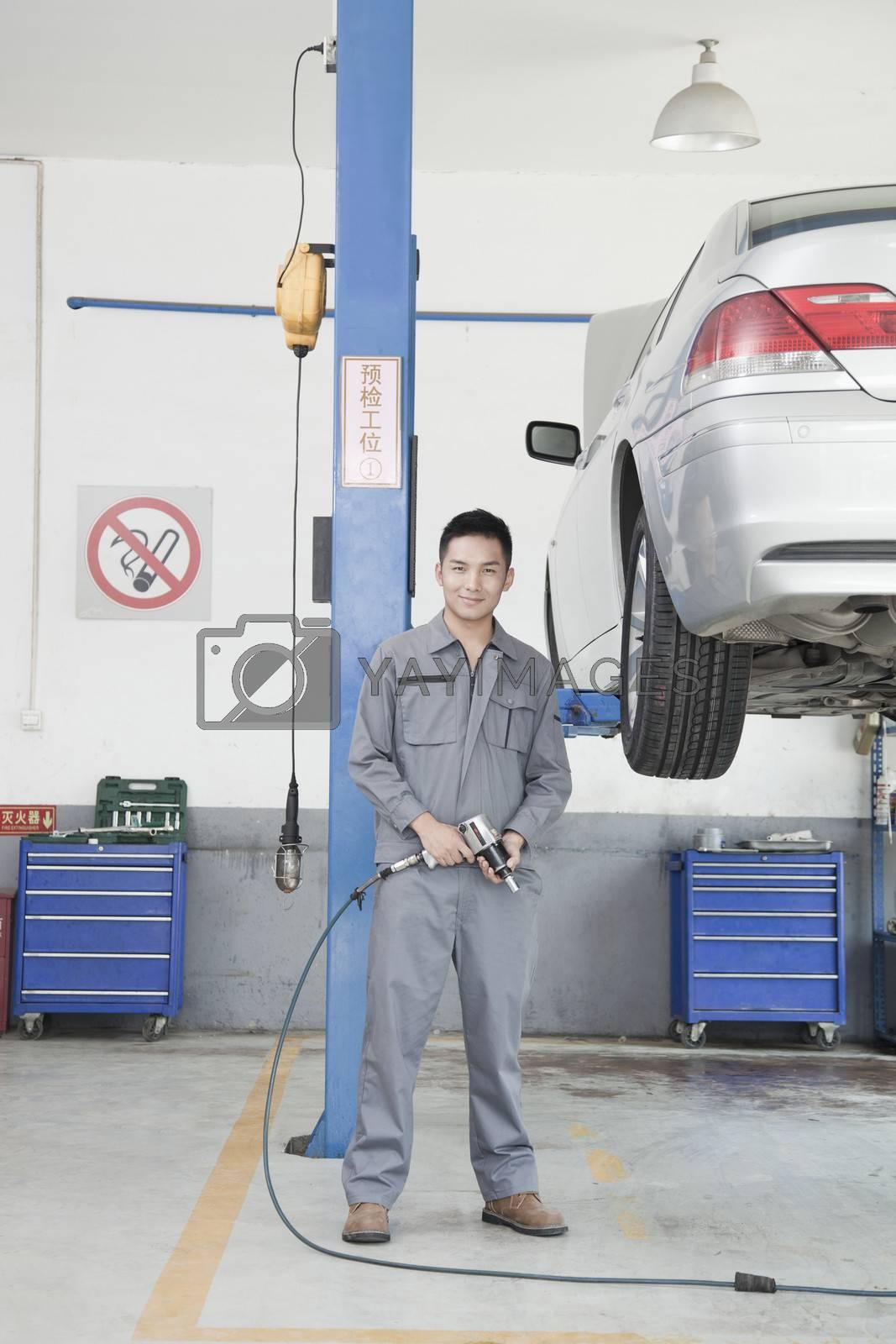 Mechanic Using Power Tool