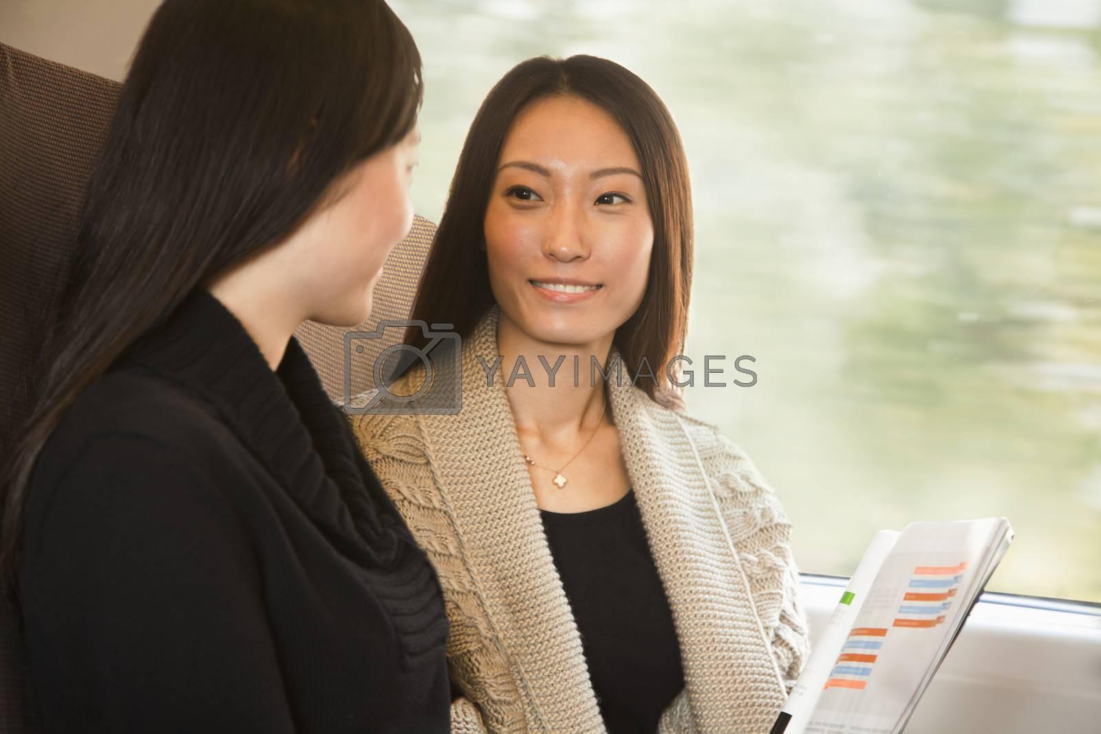Two Women Talking on a Train by XiXinXing