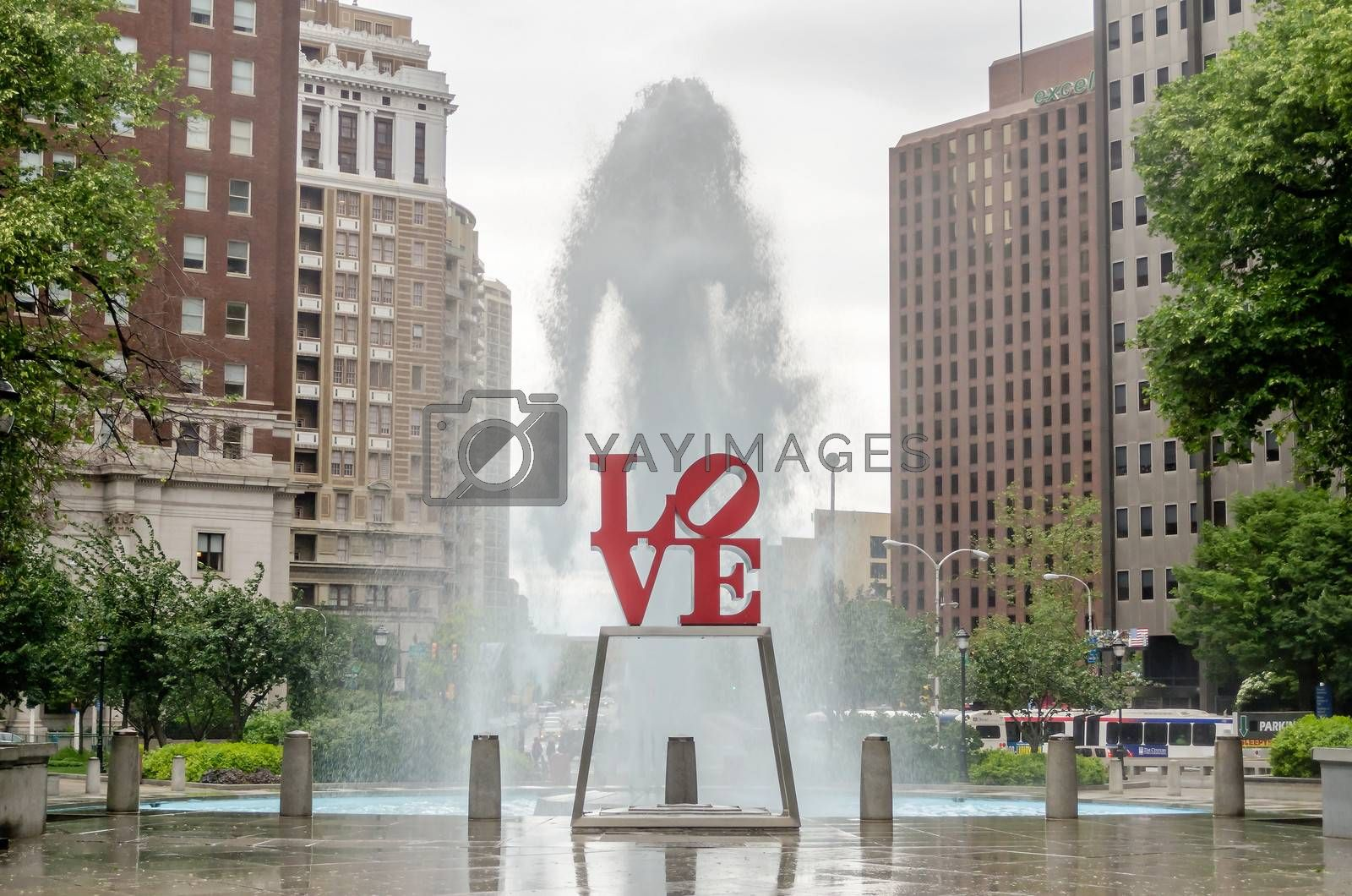 Love Statue in Philadelphia, with scenic fountain against a cloudy sky