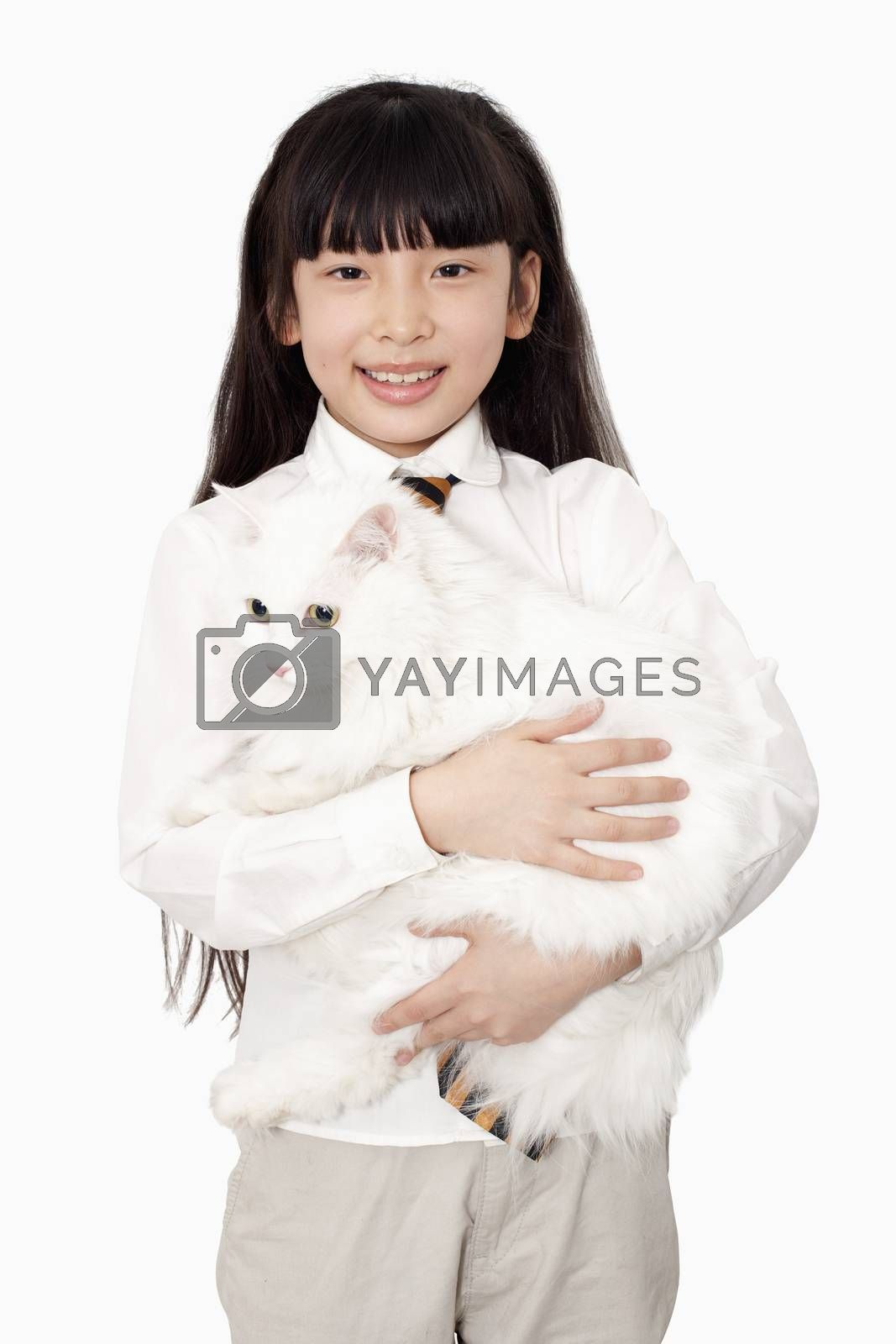 Portrait of girl in white holding a white cat