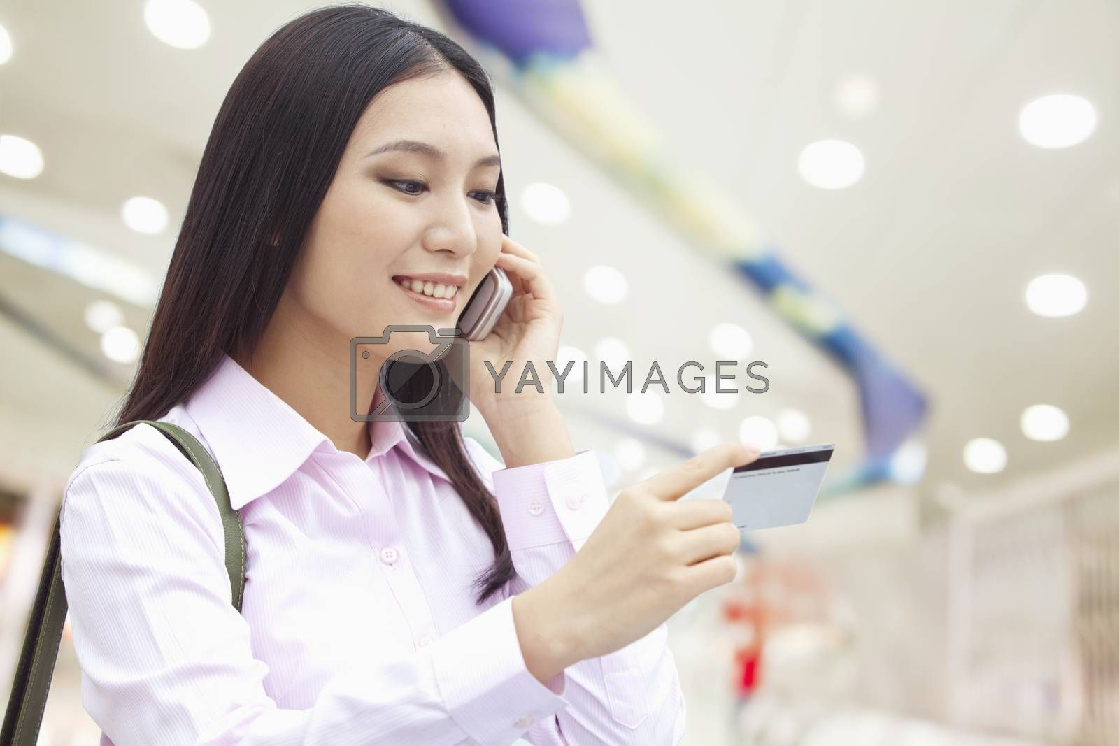 Businesswoman on the Phone, Checking the Ticket