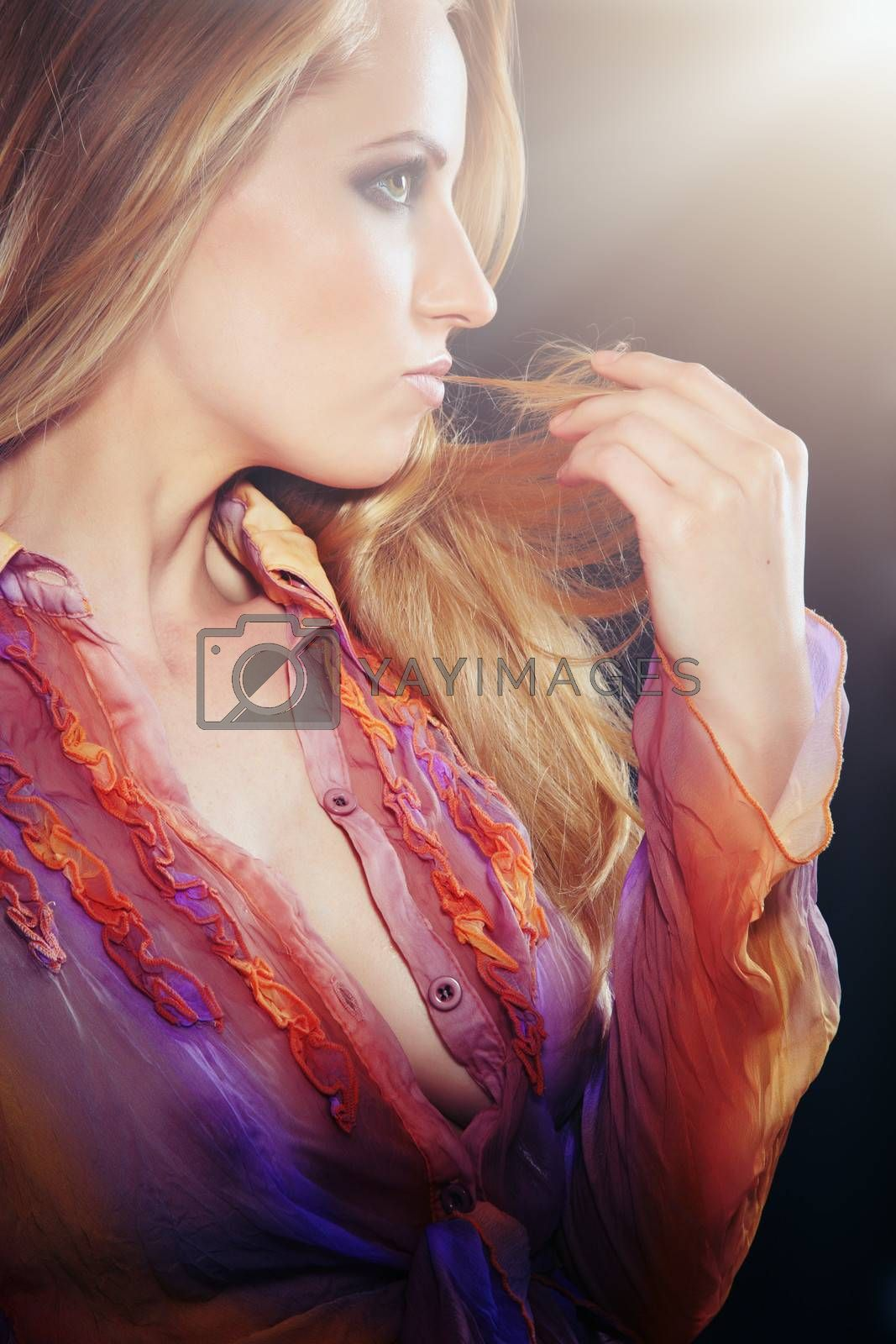 Beautiful seductive lady in studio with backlight